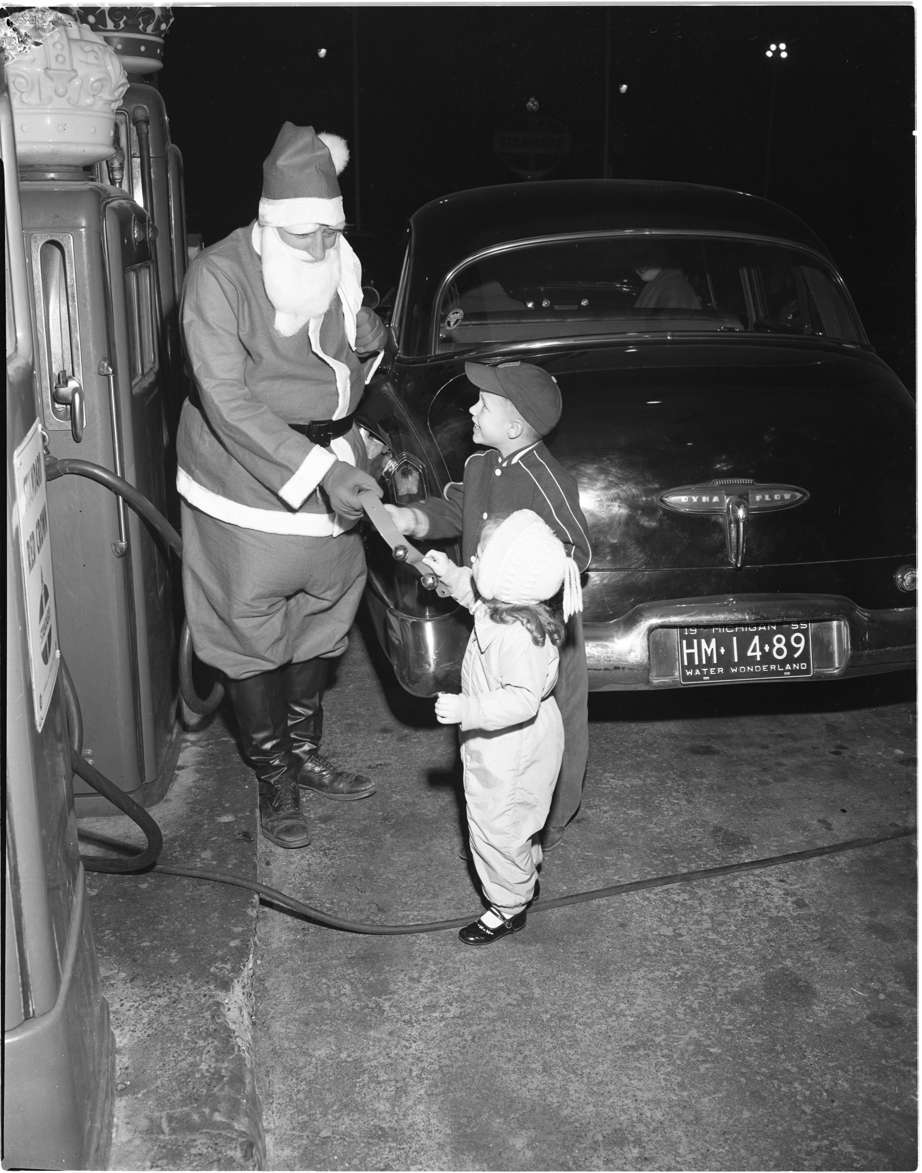 Santa Claus Greets Children At Tuomy Hills Service Station, December 1955 image