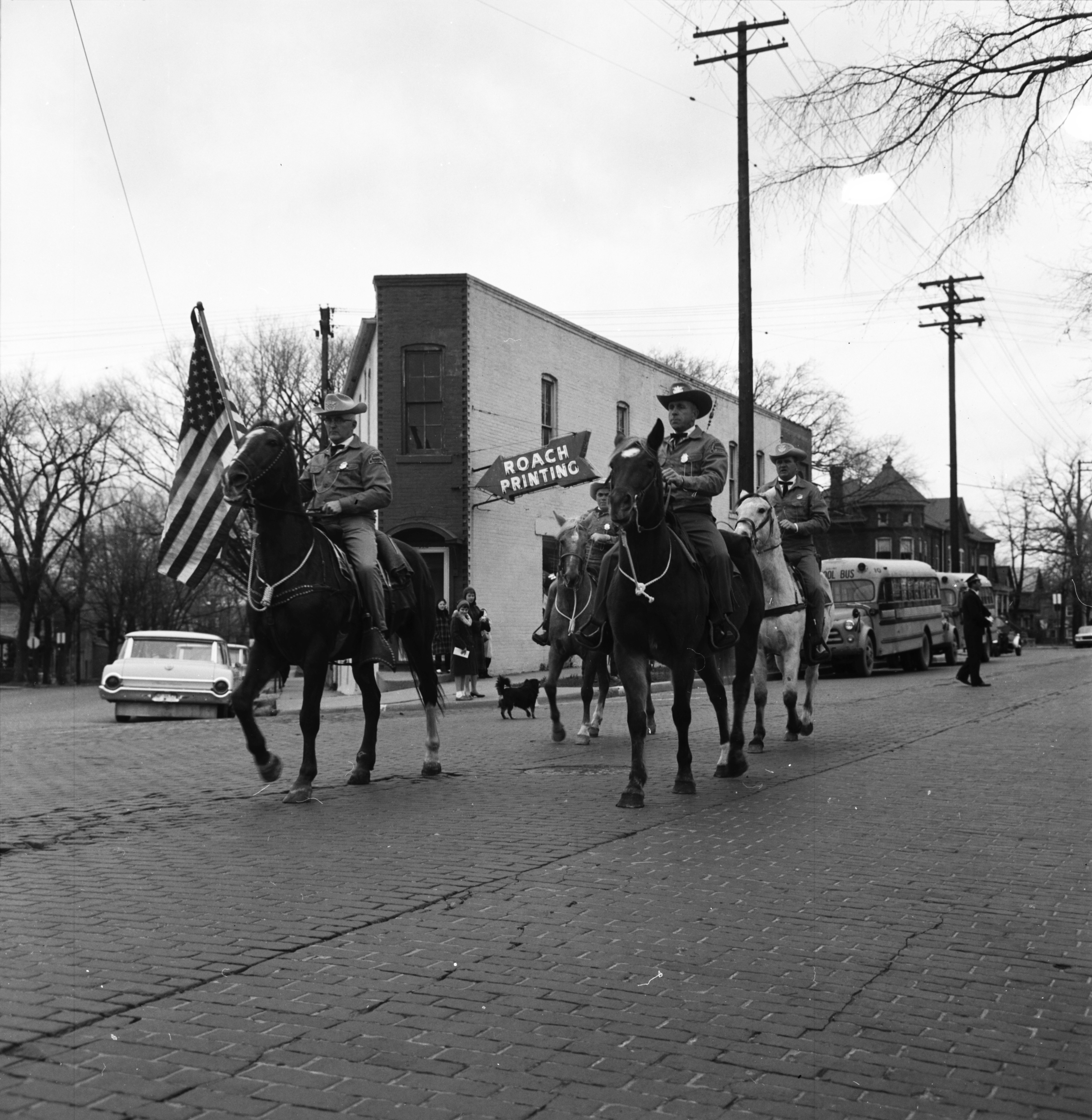 "Downtown Ann Arbor parade signaling the ""official"" start of pre-Christmas buying season, November 1963 image"