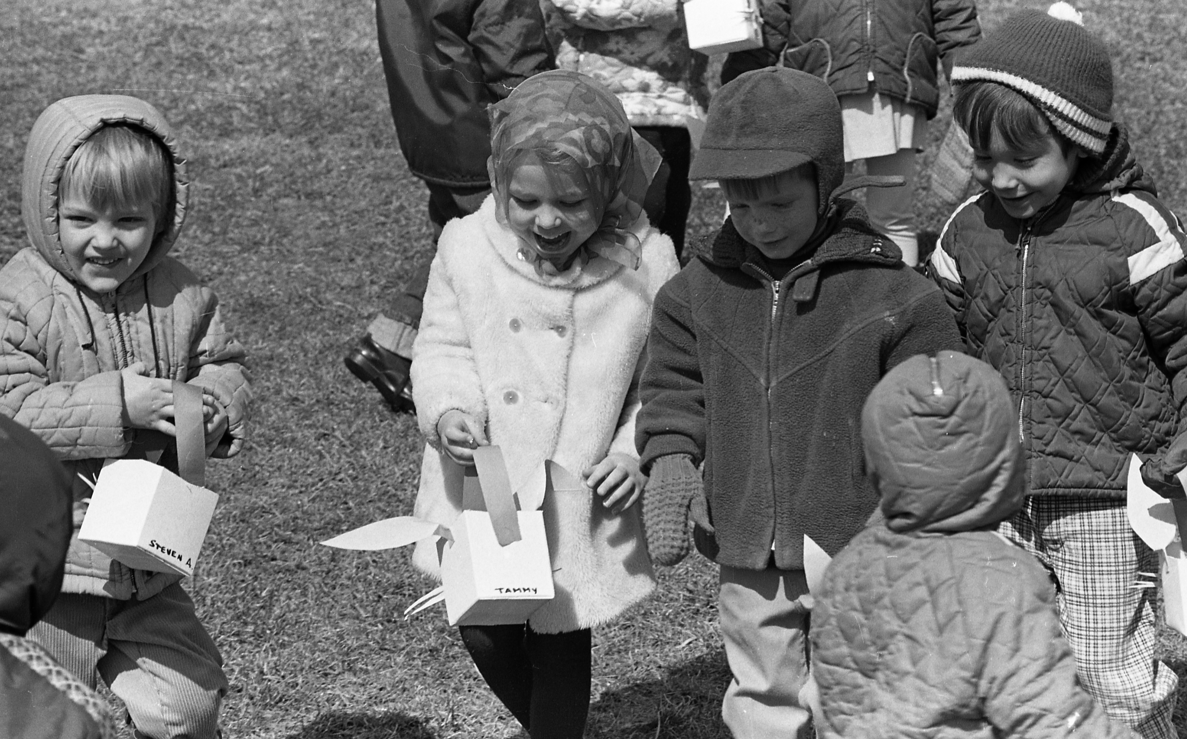 Children From Colonial Square Preschool Nursery Enjoy An Easter Egg Hunt, April 1969 image