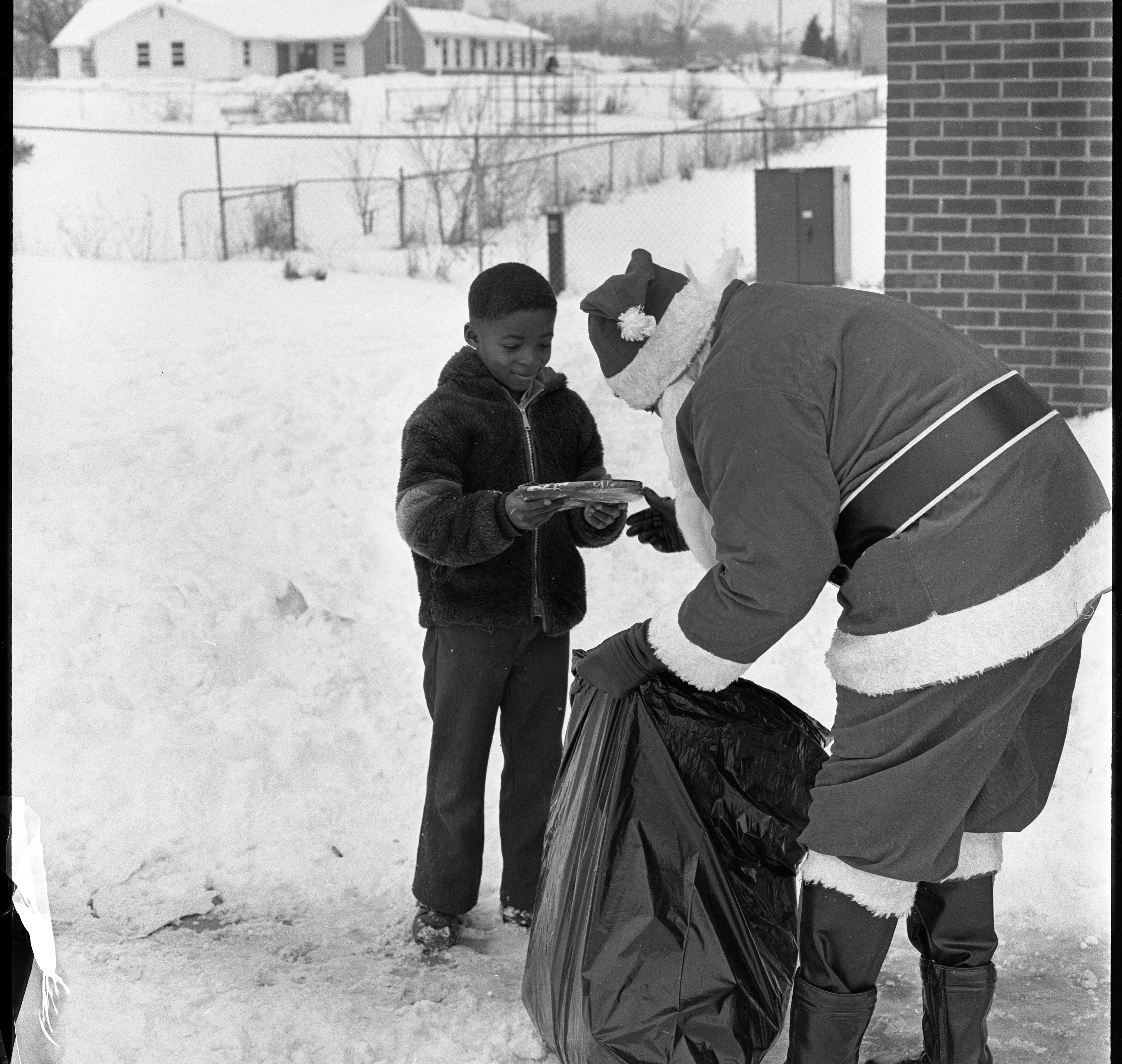 Rose Martin As Santa Gives Present To Mark Wilson, December 25, 1973 image