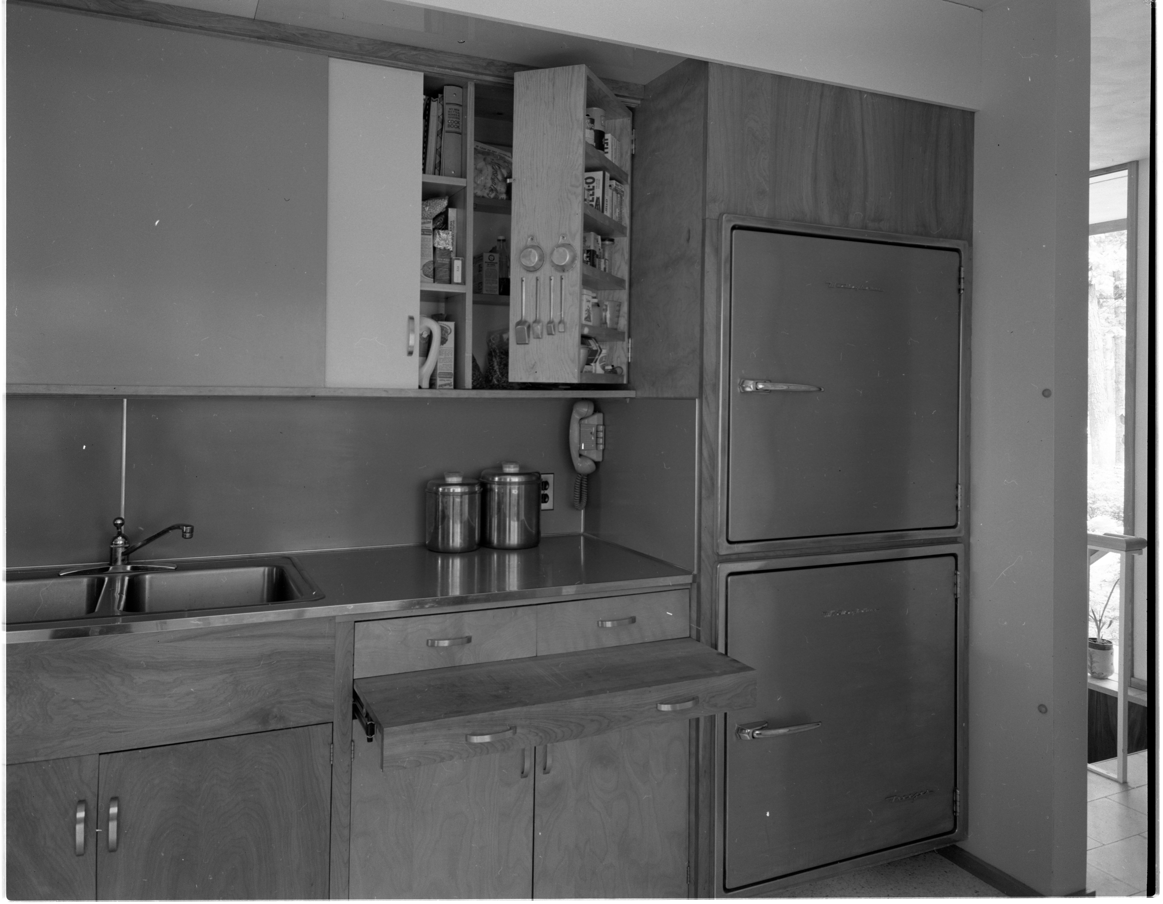 Swing-Out Cabinetry Adds Space to Kitchen of Moore Home, June 1958 image