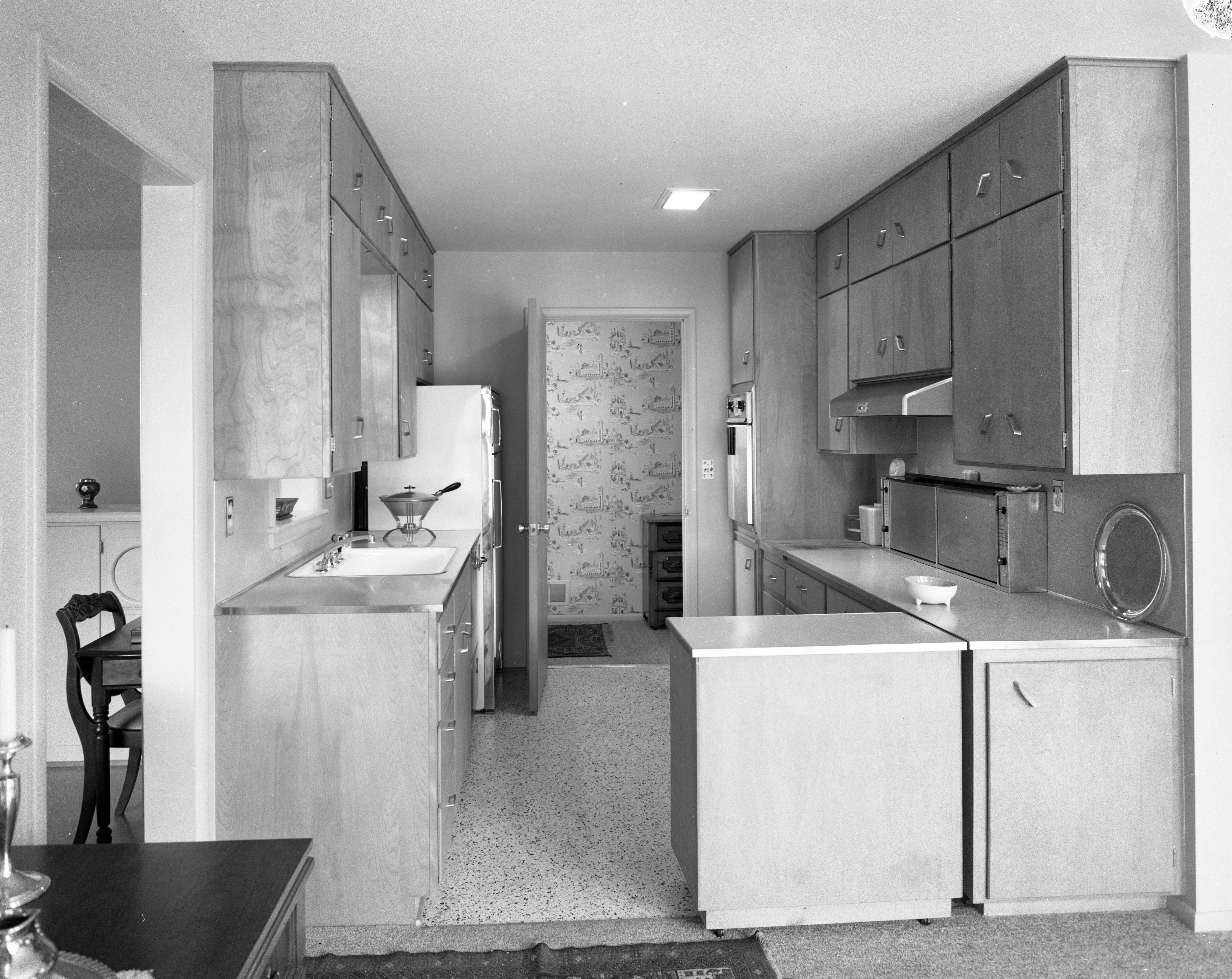 Kitchen of Cecil and Dama Creal Home On Cedar Bend Drive, April 1958 image