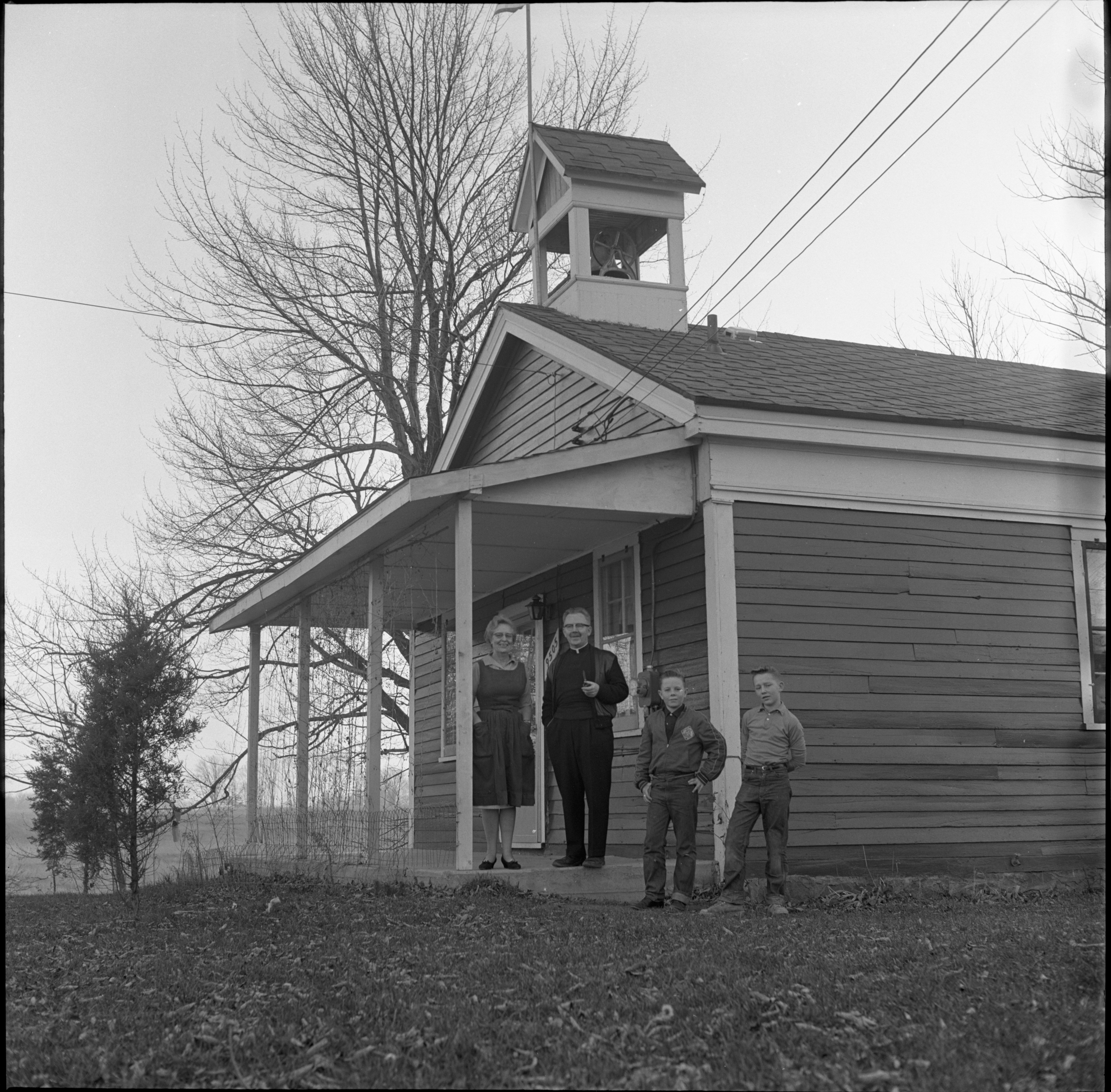 The Miller Family Outside Their Renovated Schoolhouse Home, December 1960 image