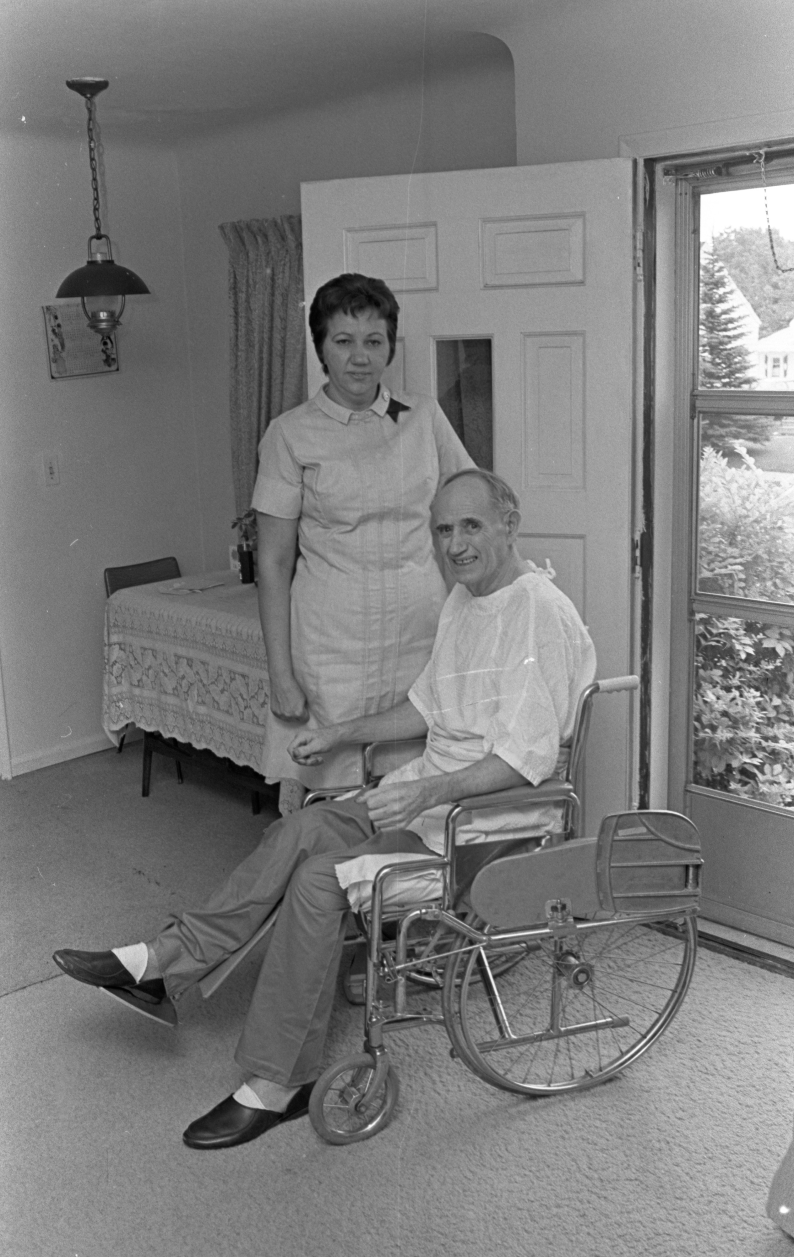 Mrs. Leonard Lewinski, Visiting Nurse, Helps Everett Fox At His Home, July 1970 image