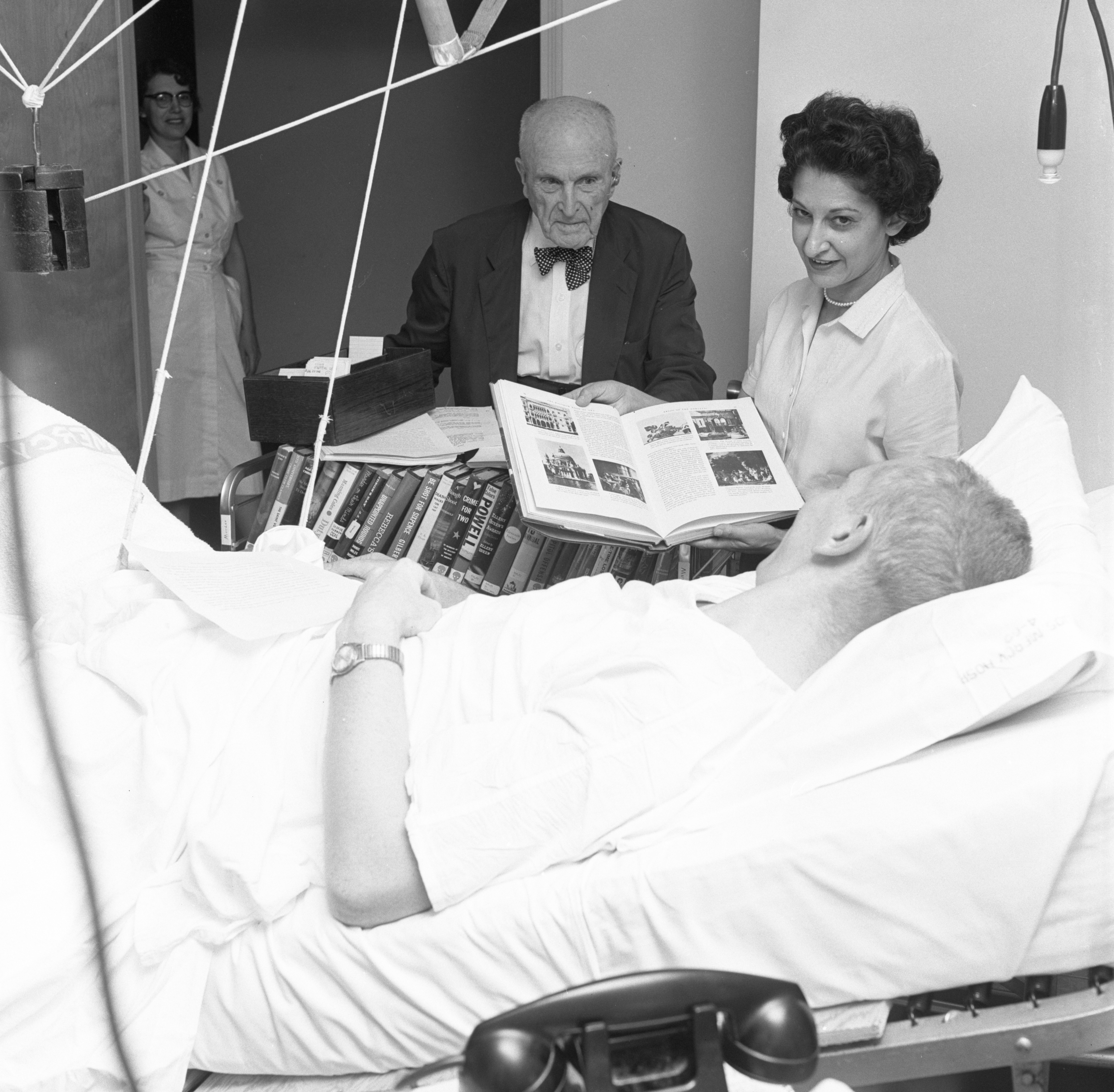Friends Of The Ann Arbor Public Library Offer Services To A Patient At St. Joseph Mercy Hospital, July 1960 image
