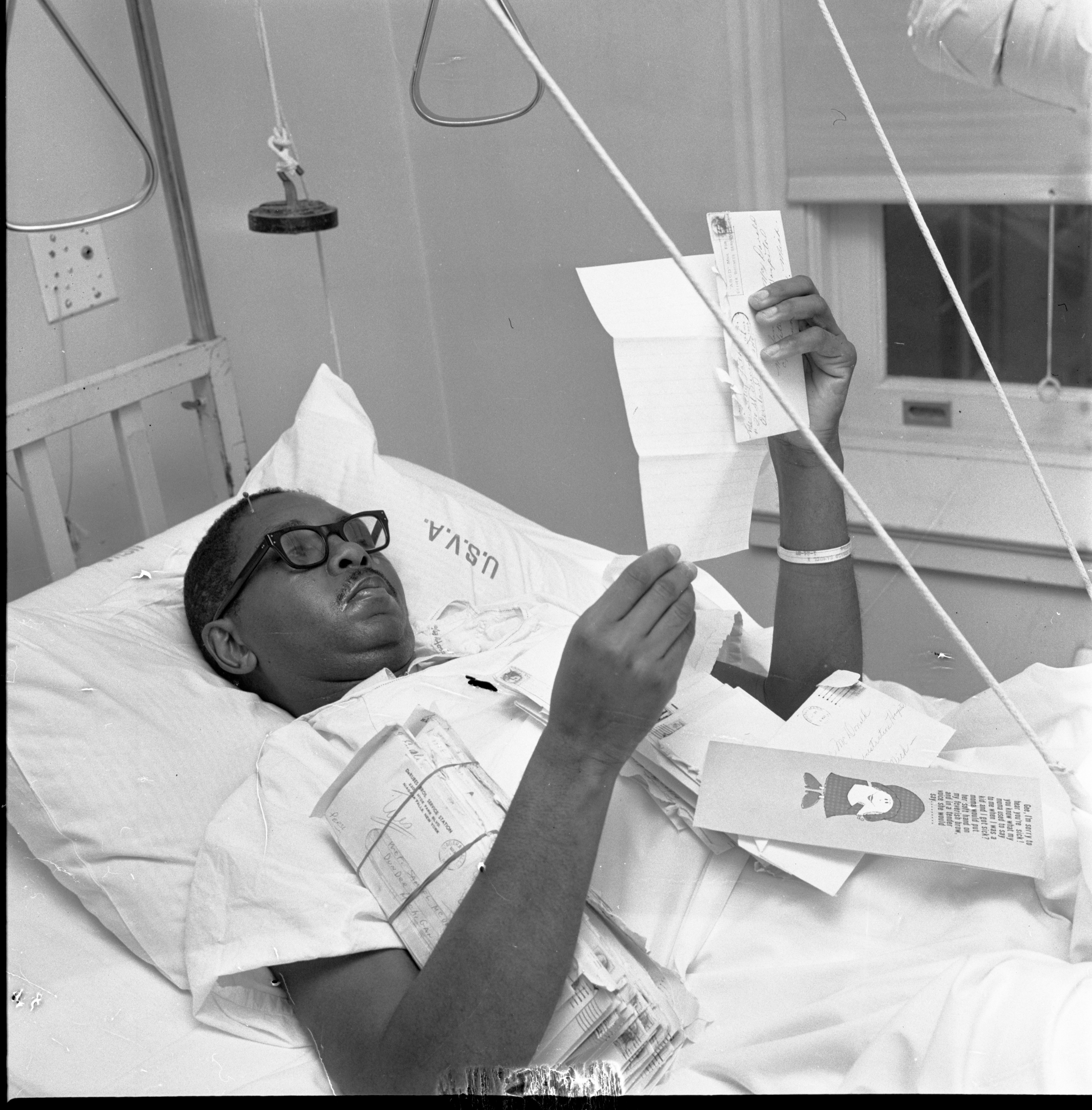 Sam McDonald Reads His Mail While In Veterans Hospital, March 1964 image