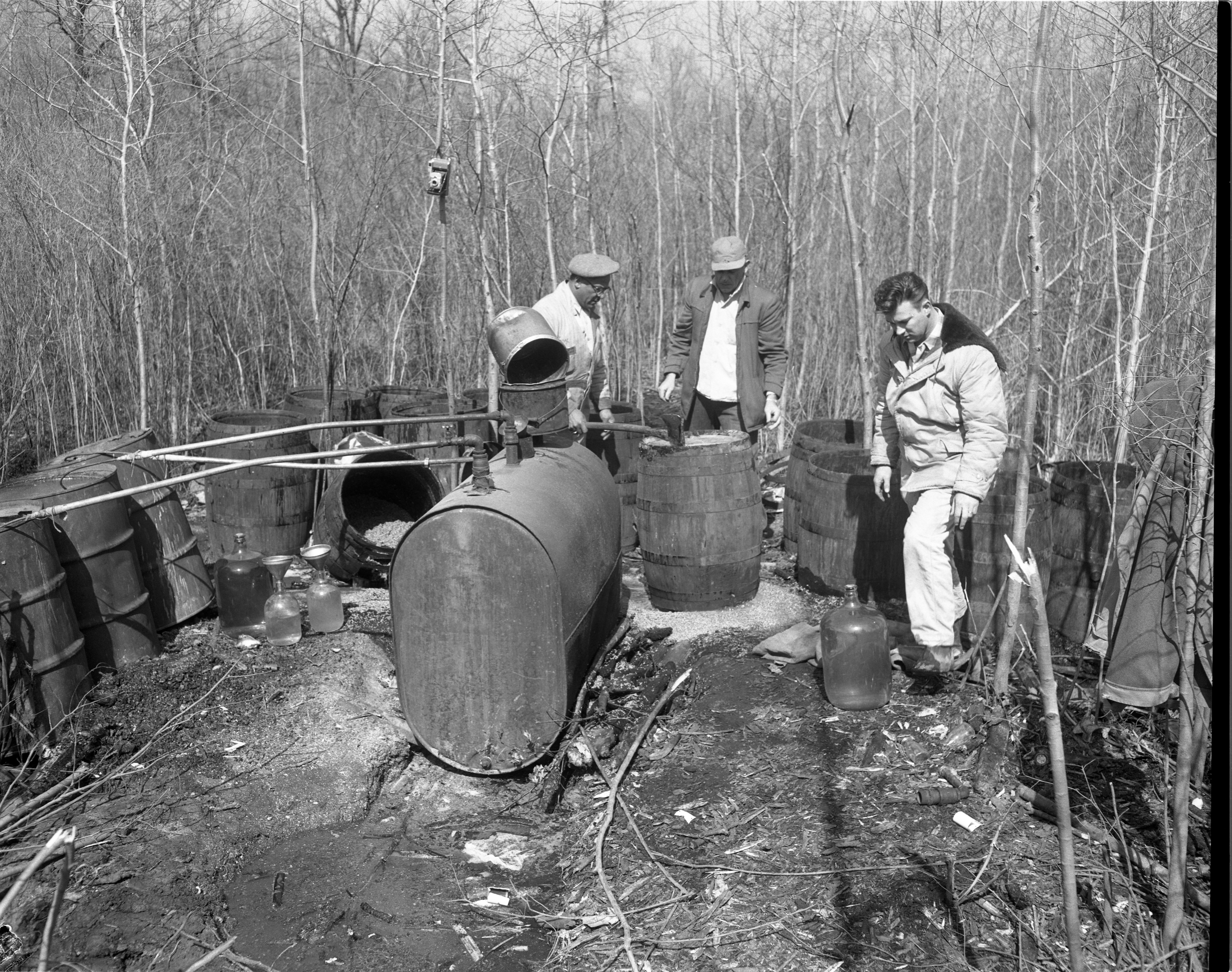 Michigan State Police Destroy Moonshine Still Found In Sumpter Township, March 30, 1959 image
