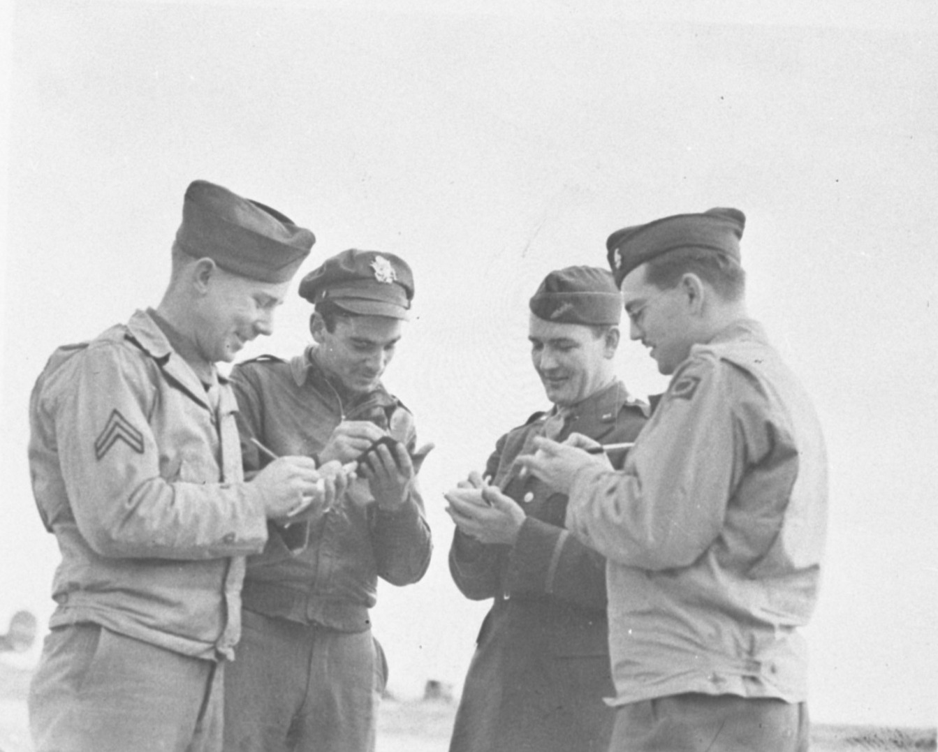 "United Press European War correspondent Clinton Beach ""Pat"" Conger (far right), with other soldiers, April 1944 image"