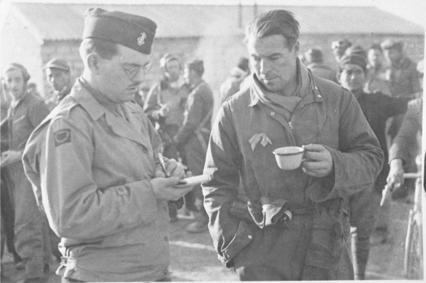 "United Press European War correspondent Clinton Beach ""Pat"" Conger (left), taking notes, April 1944 image"