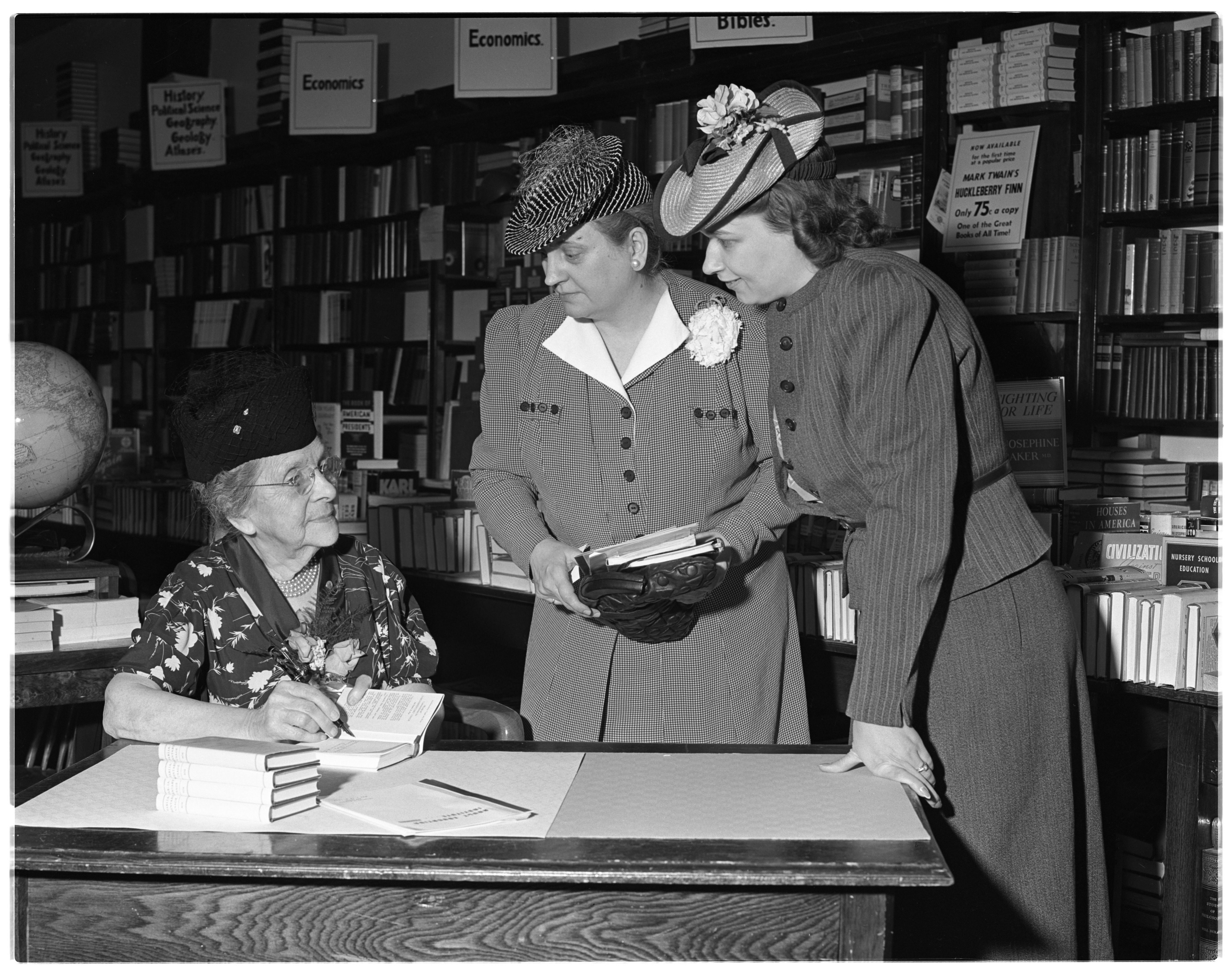 Emma Fox Autographs Her Book 'Parliamentary Law' At Slater's Bookstore, May 1939 image