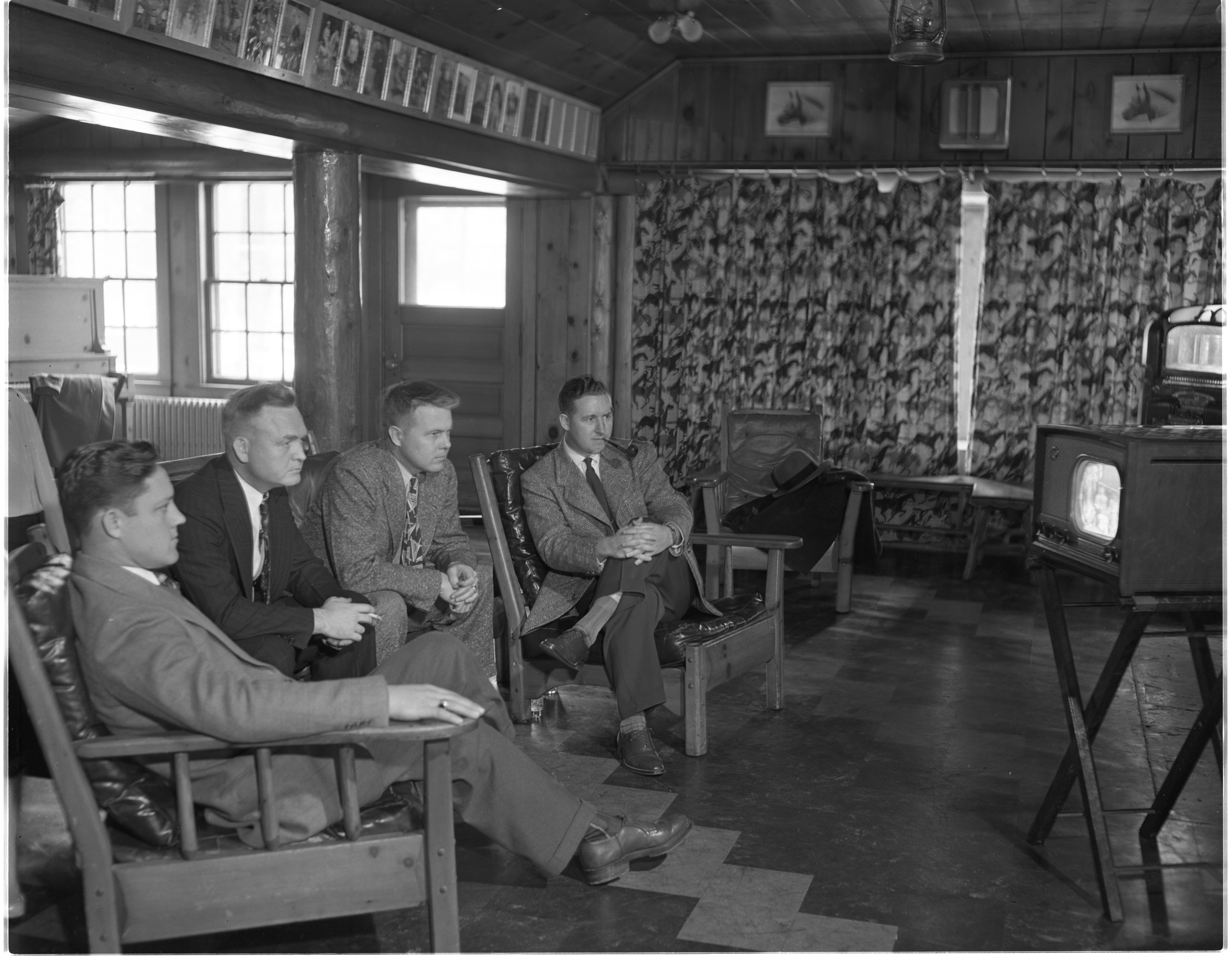 Air Force Officers Stationed At The University Of Michigan Watch The Army-Navy Football Game On TV At The Saddle Ridge Club - November 26, 1949 image