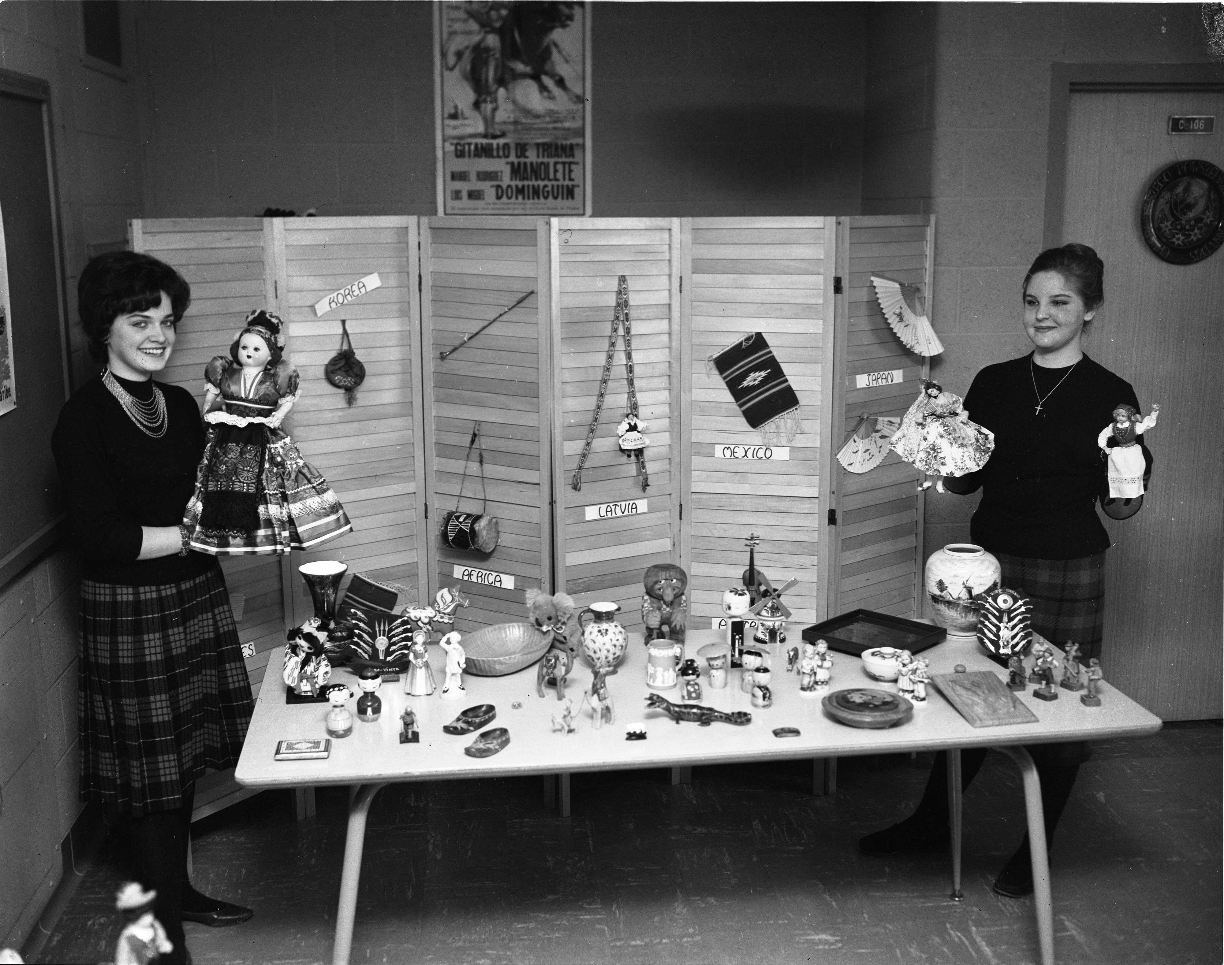 Ann Arbor High School Students, Pegue Habsburg & Karen Braun, At Display Table For Youth For Understanding 10th Anniversary, March 3, 1962 image