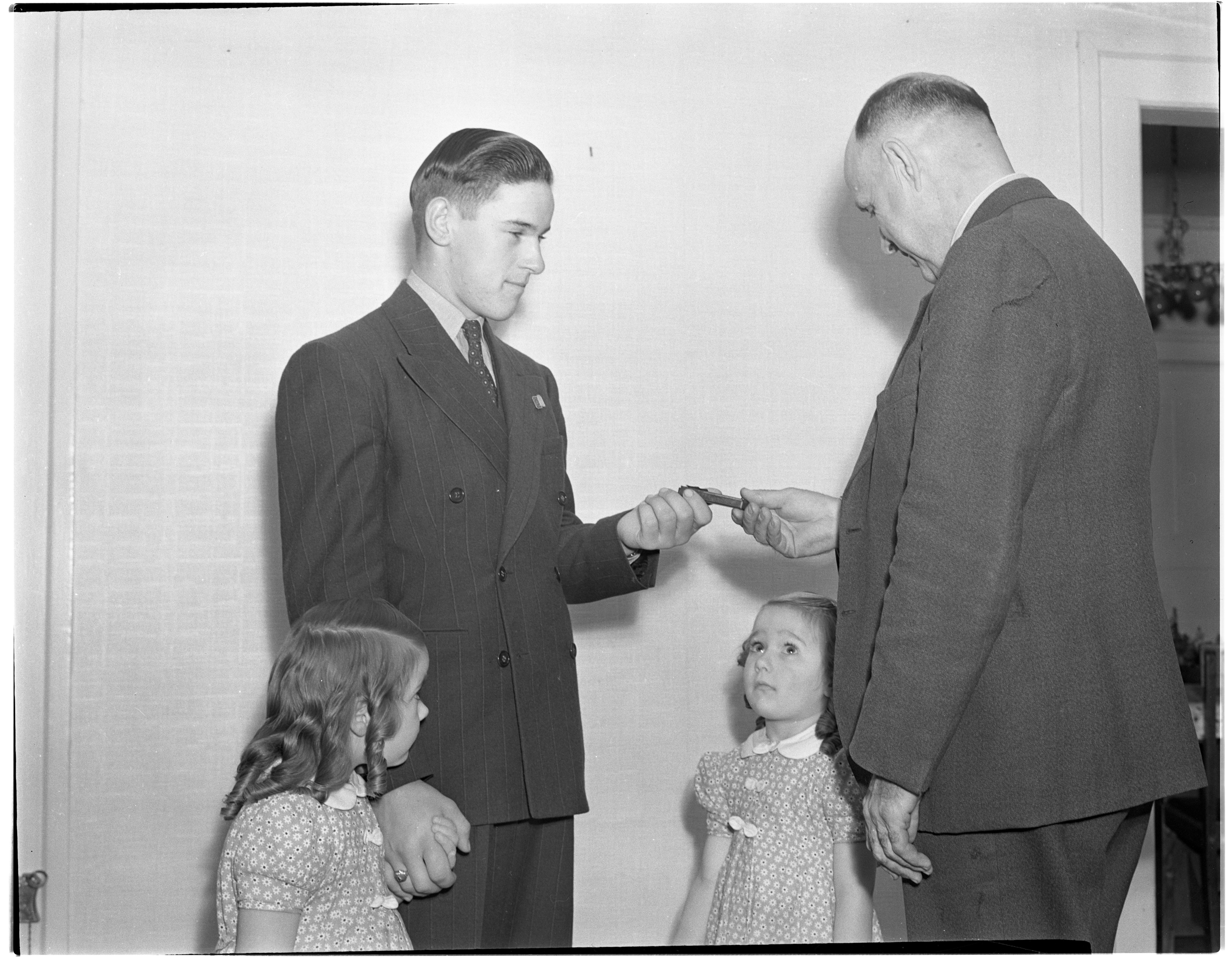 Robert Mast Receives 4-H Medal from Harold Osler, November 1938 image