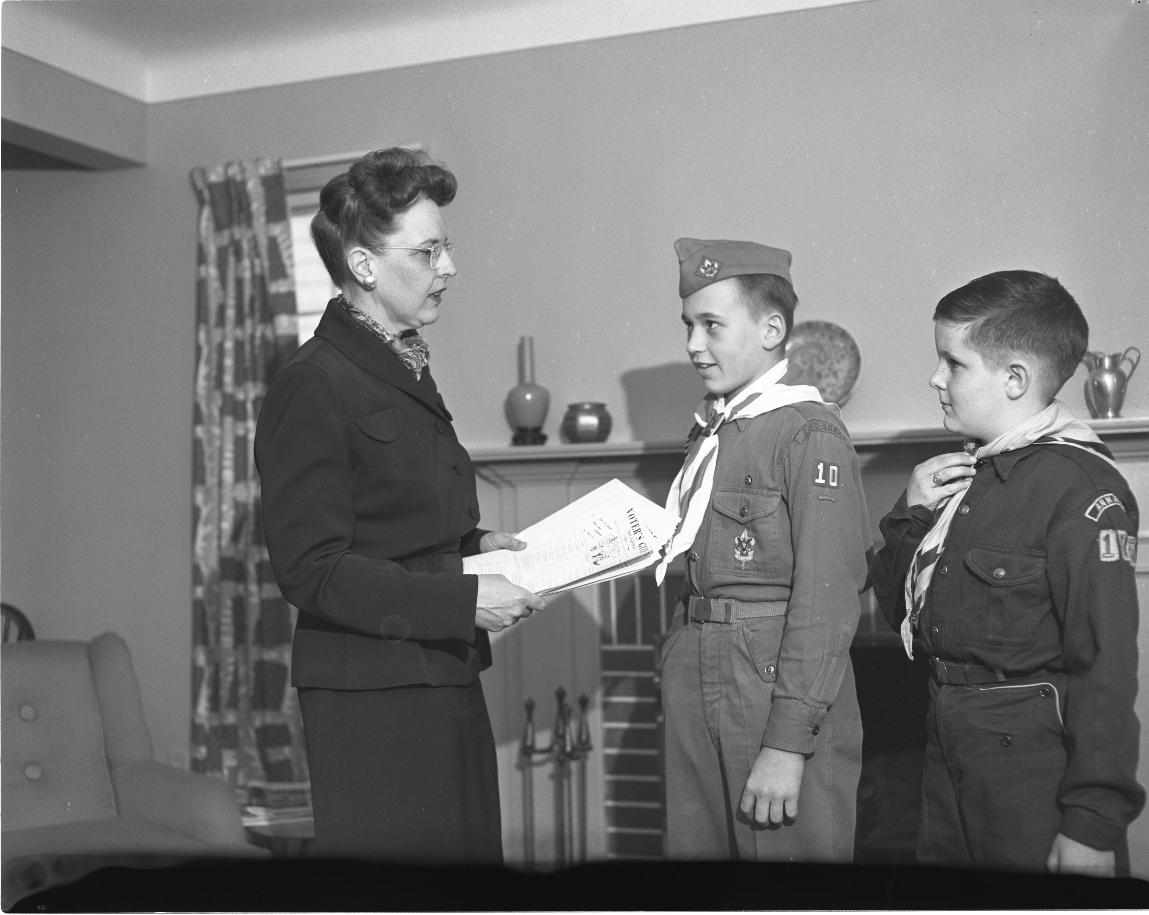 Boy Scouts Assist The League Of Women Voters With Distributing Voter Information, March 1952 image
