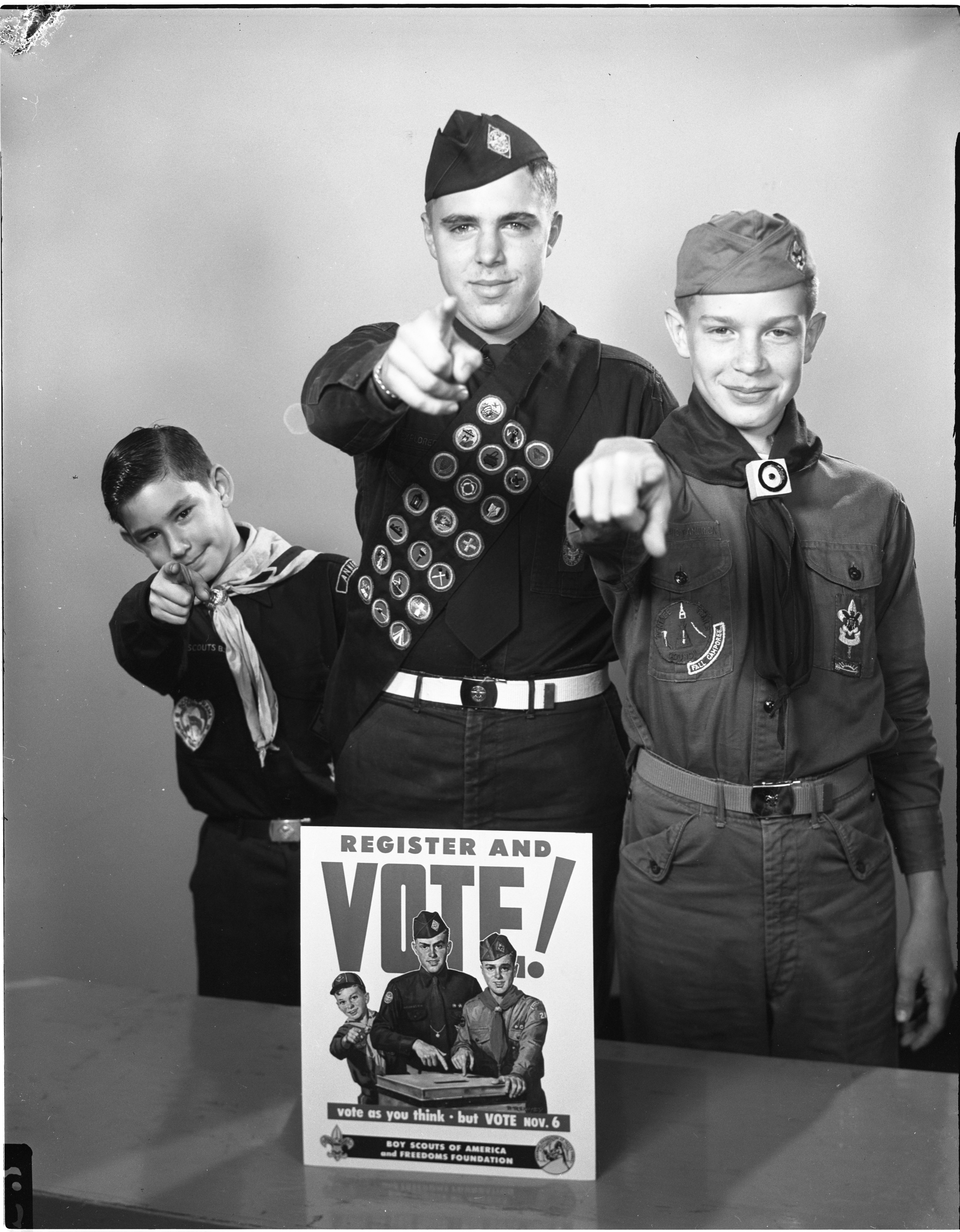 Boy Scouts Re-Enact Poster Urging Residents To Vote, October 1956 image