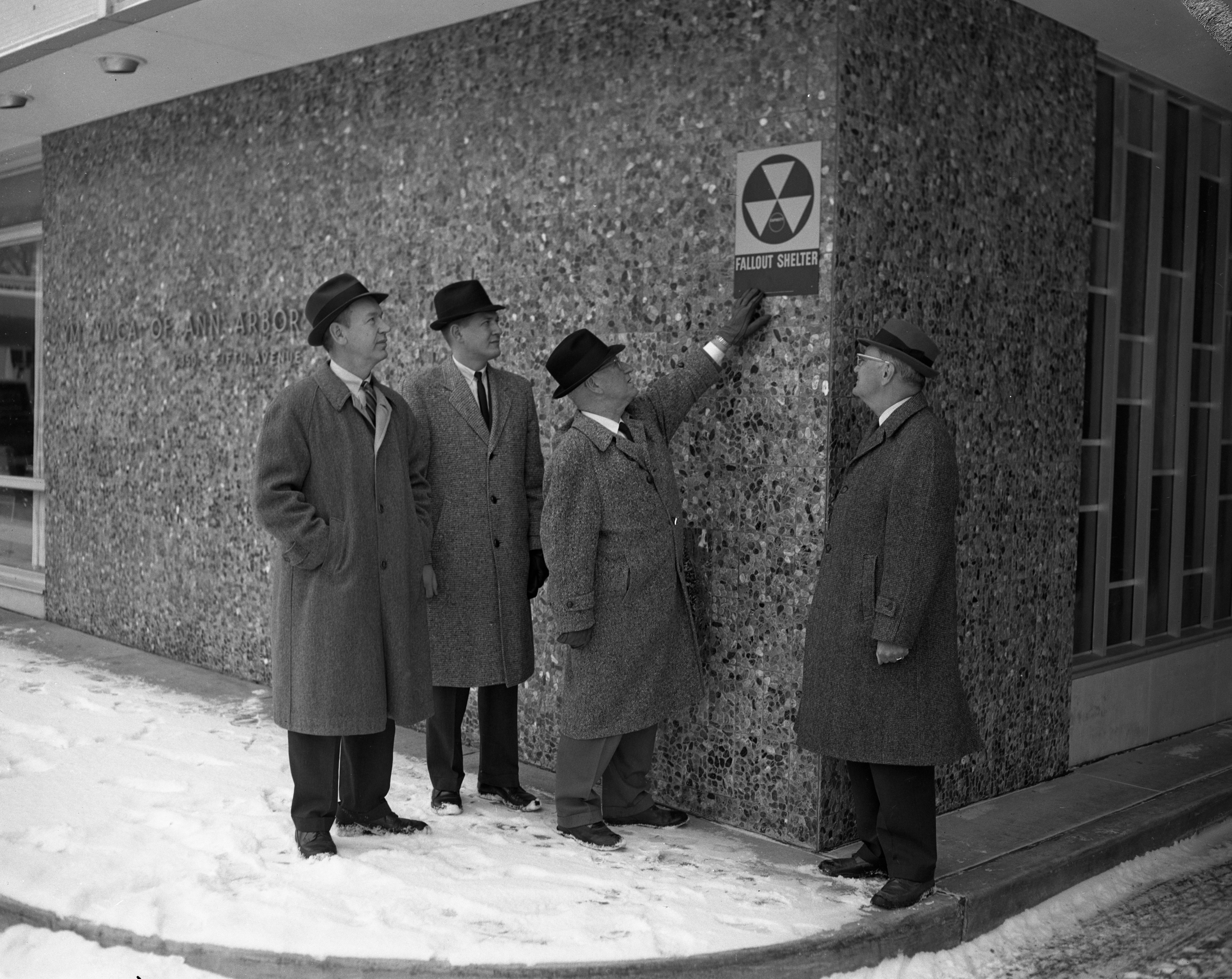 City leaders place the first fallout shelter sign on the YM-YWCA building downtown, February 1963 image