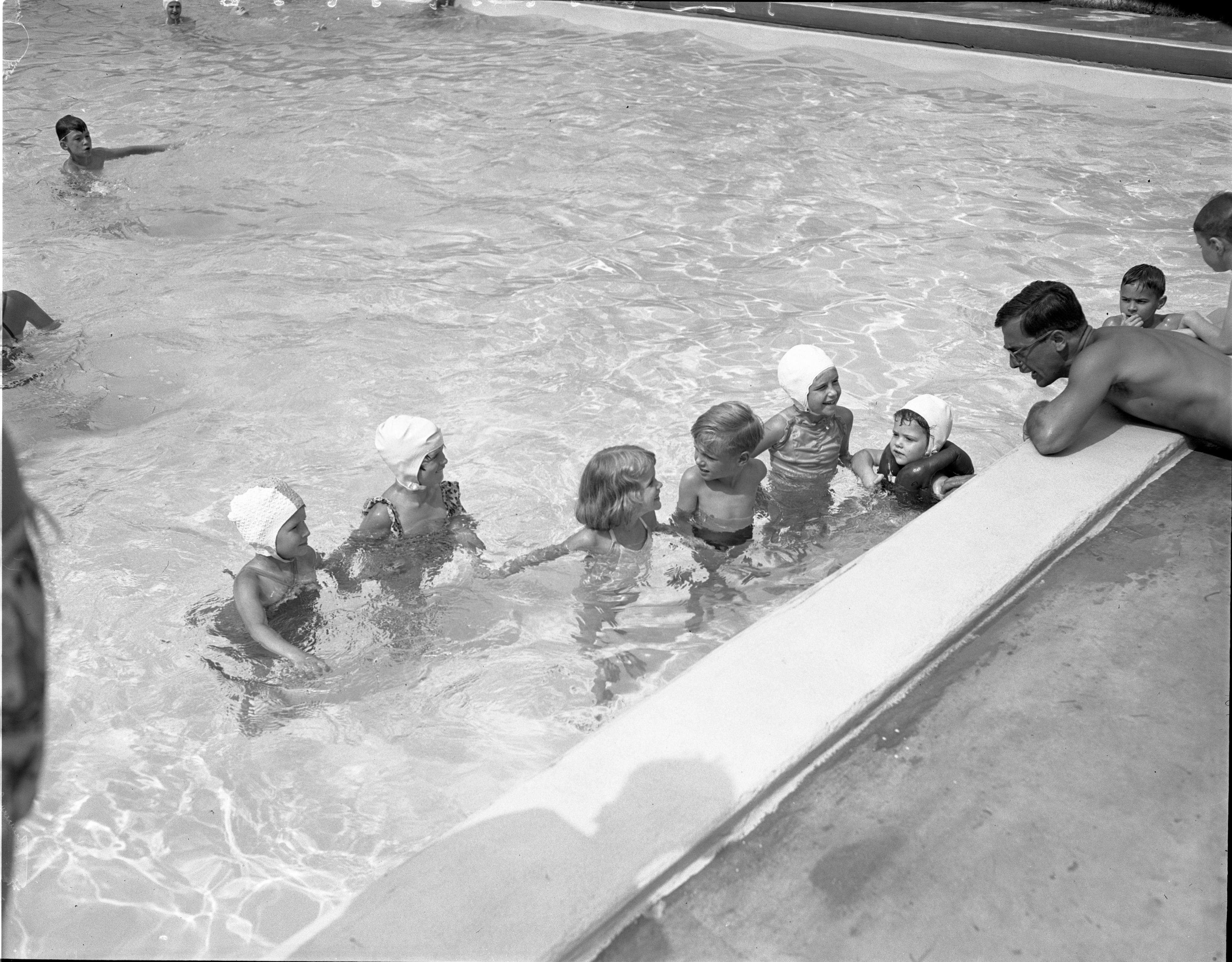 Alex Canja Gives Swimming Advice To Children At Barton Hills Country Club, July 1951 image