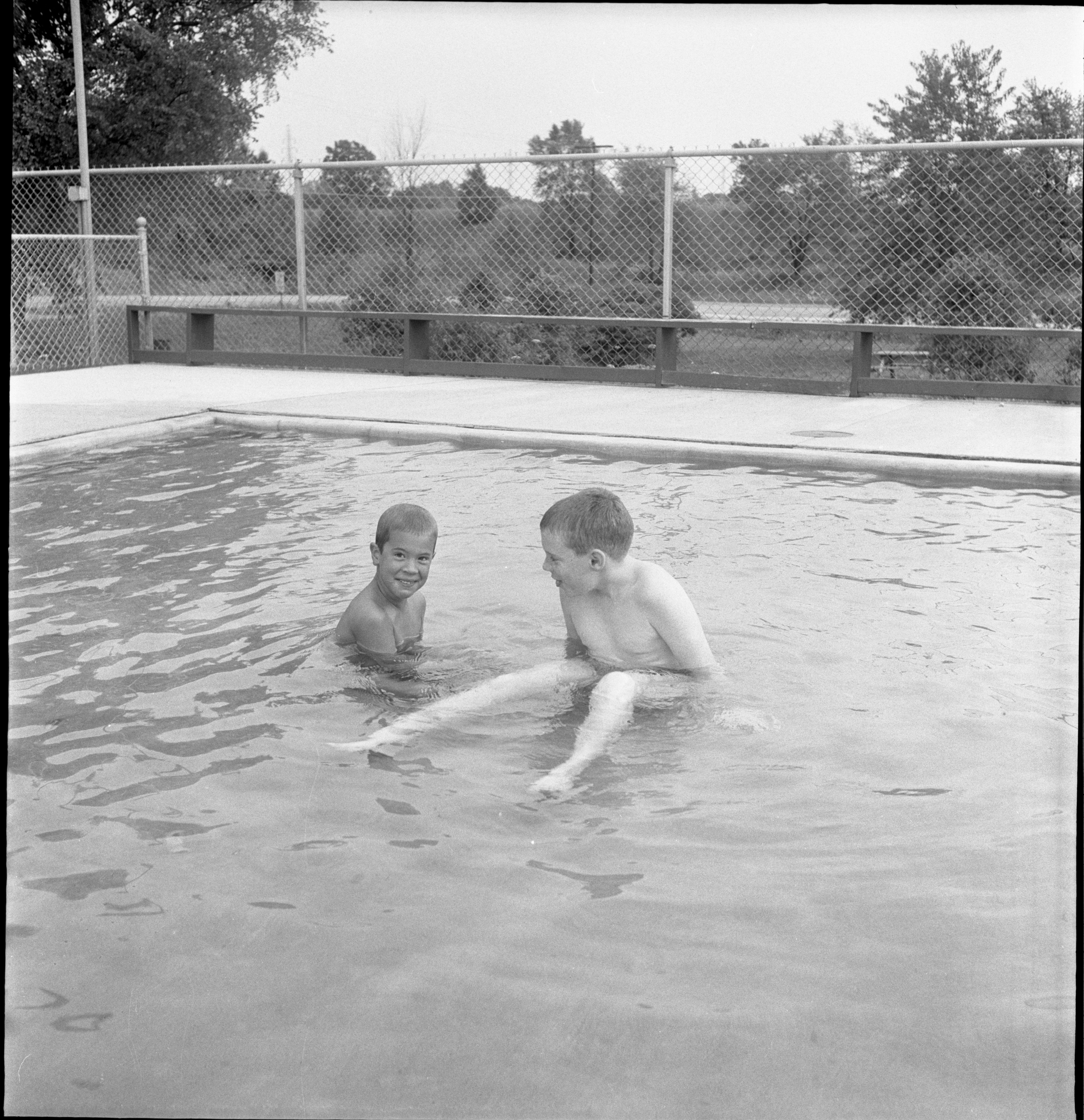 Robbie Bolt & Bob Berry Enjoy The Wading Pool At The Chippewa Hills Swimming Club, July 1962 image
