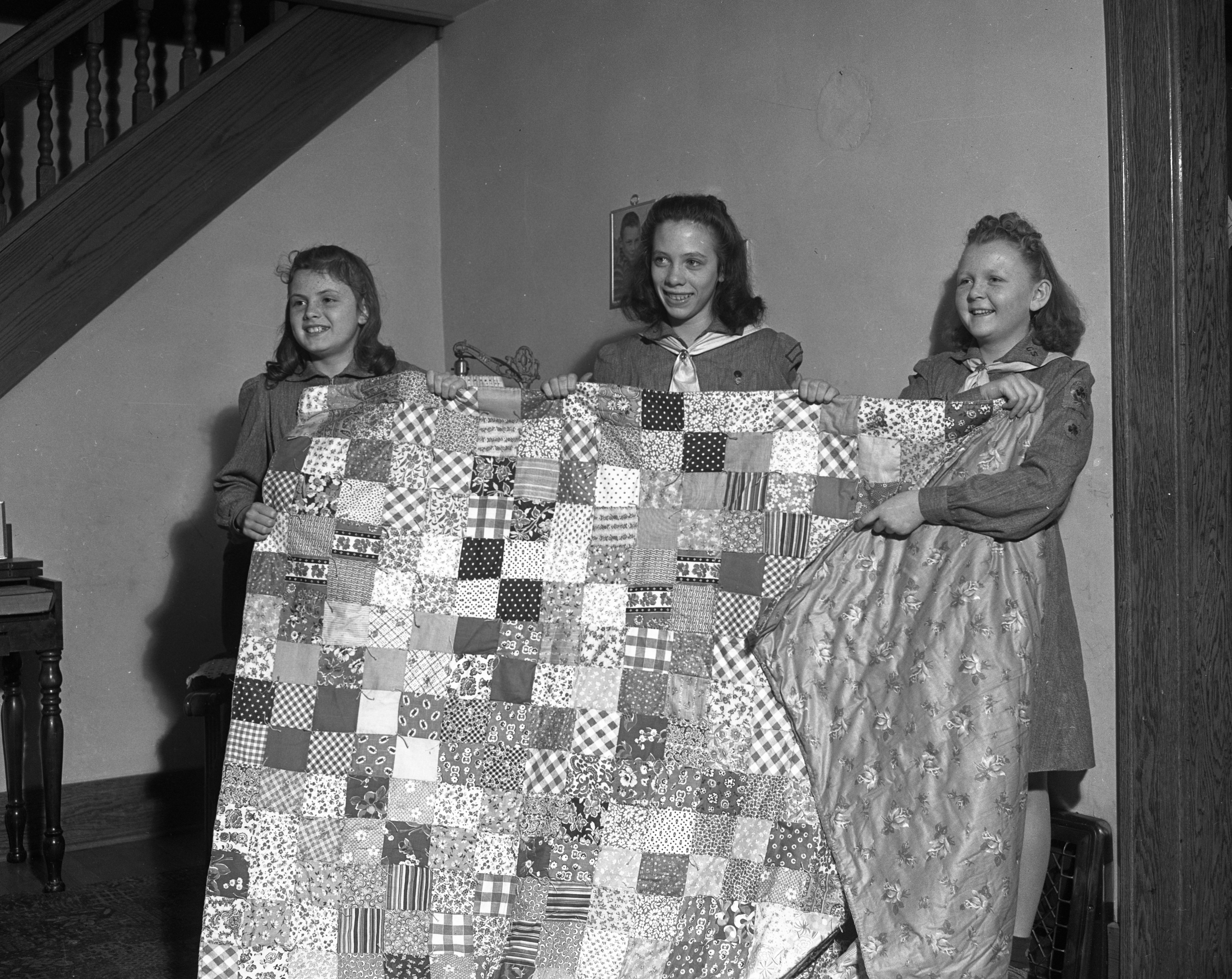 Girl Scouts make quilt, April 1942 image