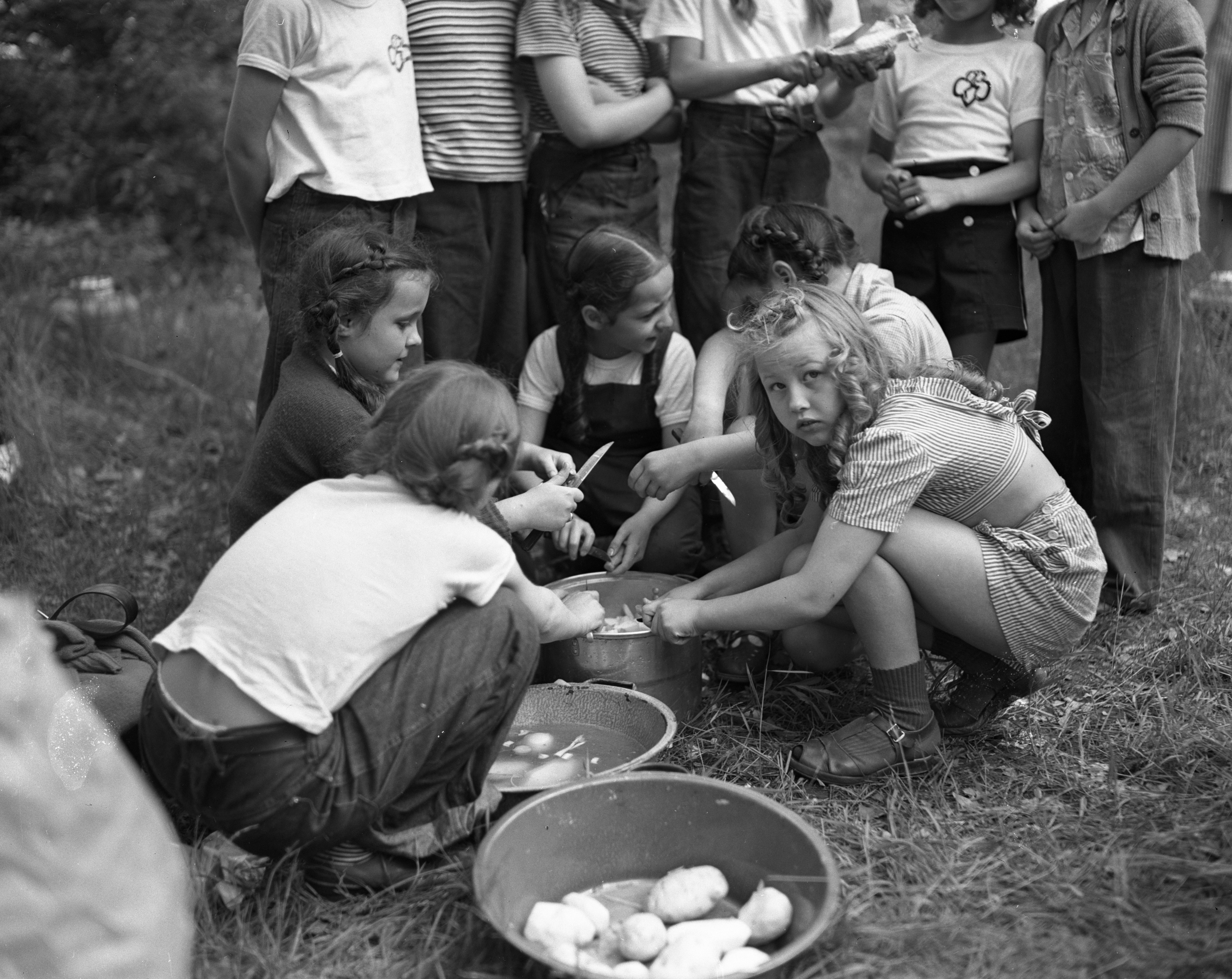 Girl Scout Cooking Out at  Camp Hilltop, June 1947 image