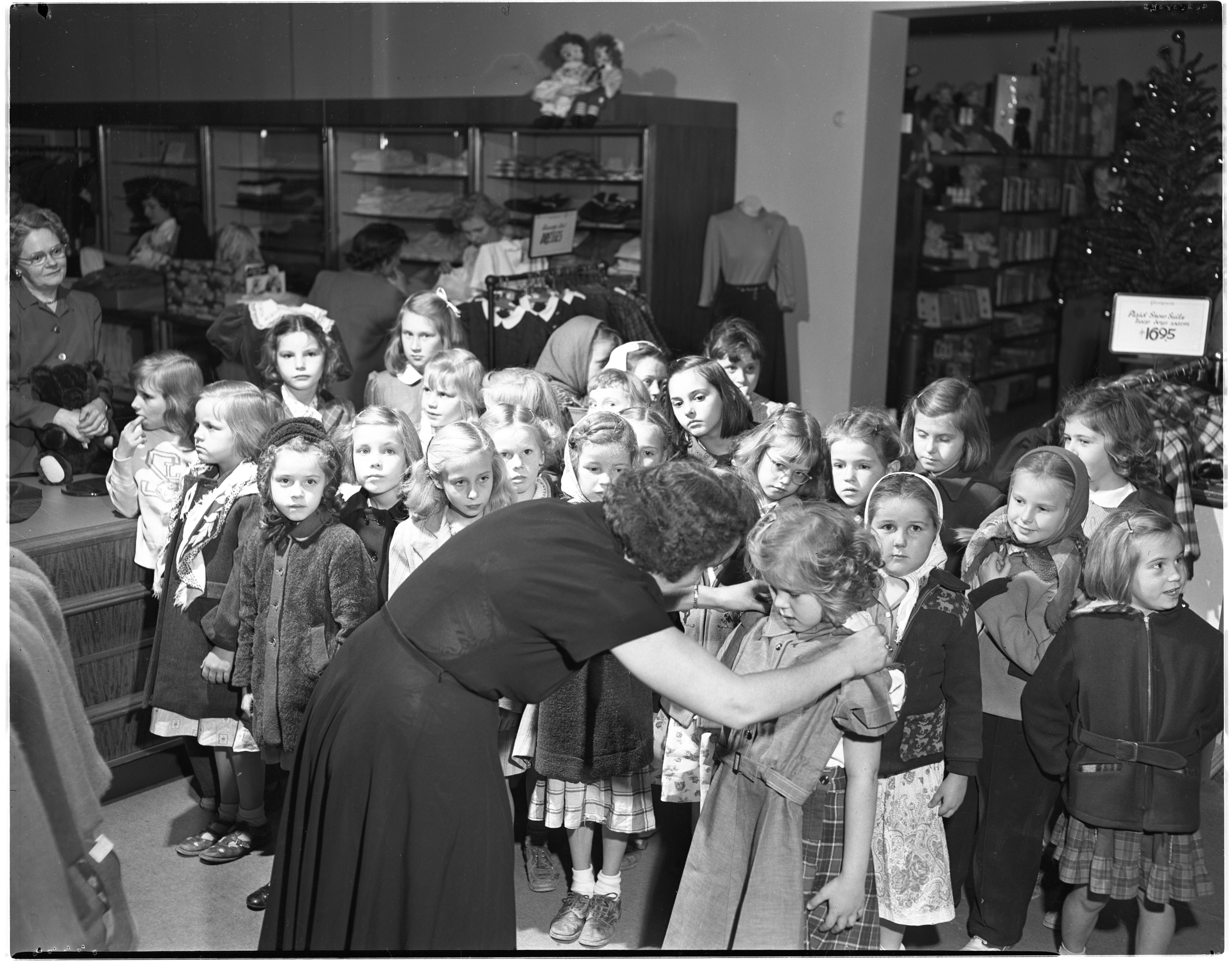 Pittsfield Girl Scouts Wait To Be Measured For New Uniforms At Goodyears, September 1949 image