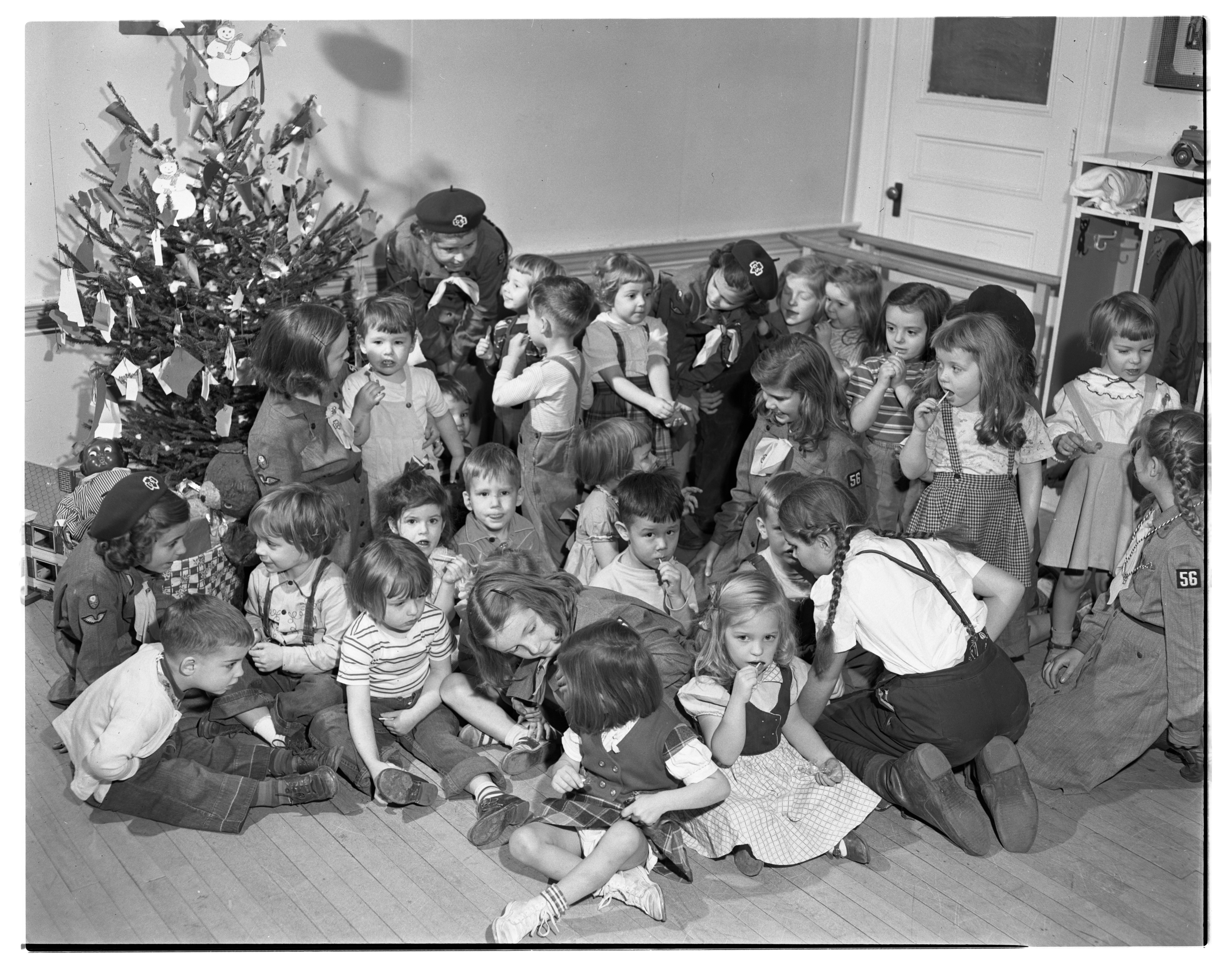 Girl Scouts Throw Party For Perry Nursery School Students, December 1949 image
