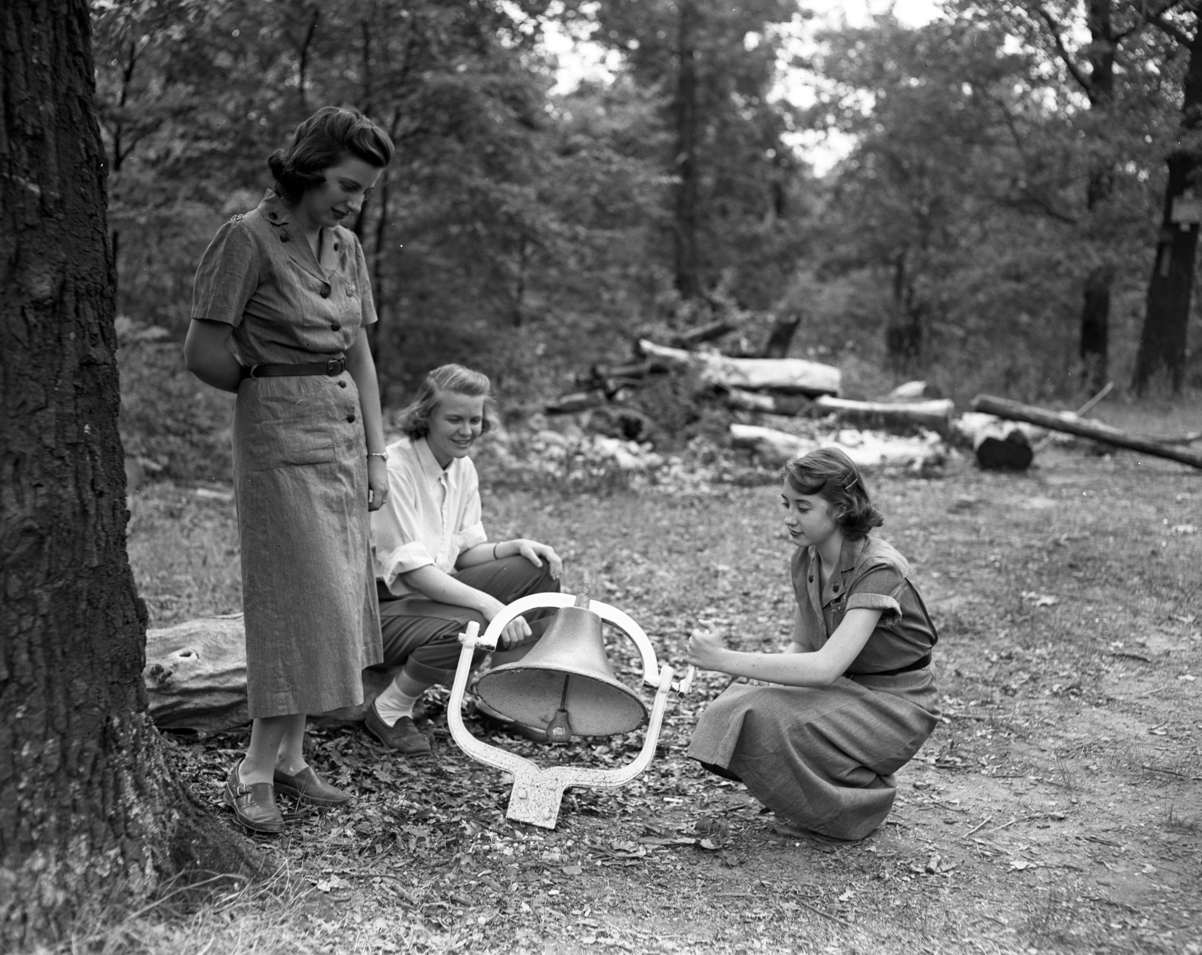 Girl Scouts Ready the Dinner Bell at  Camp Hilltop, August 1951 image