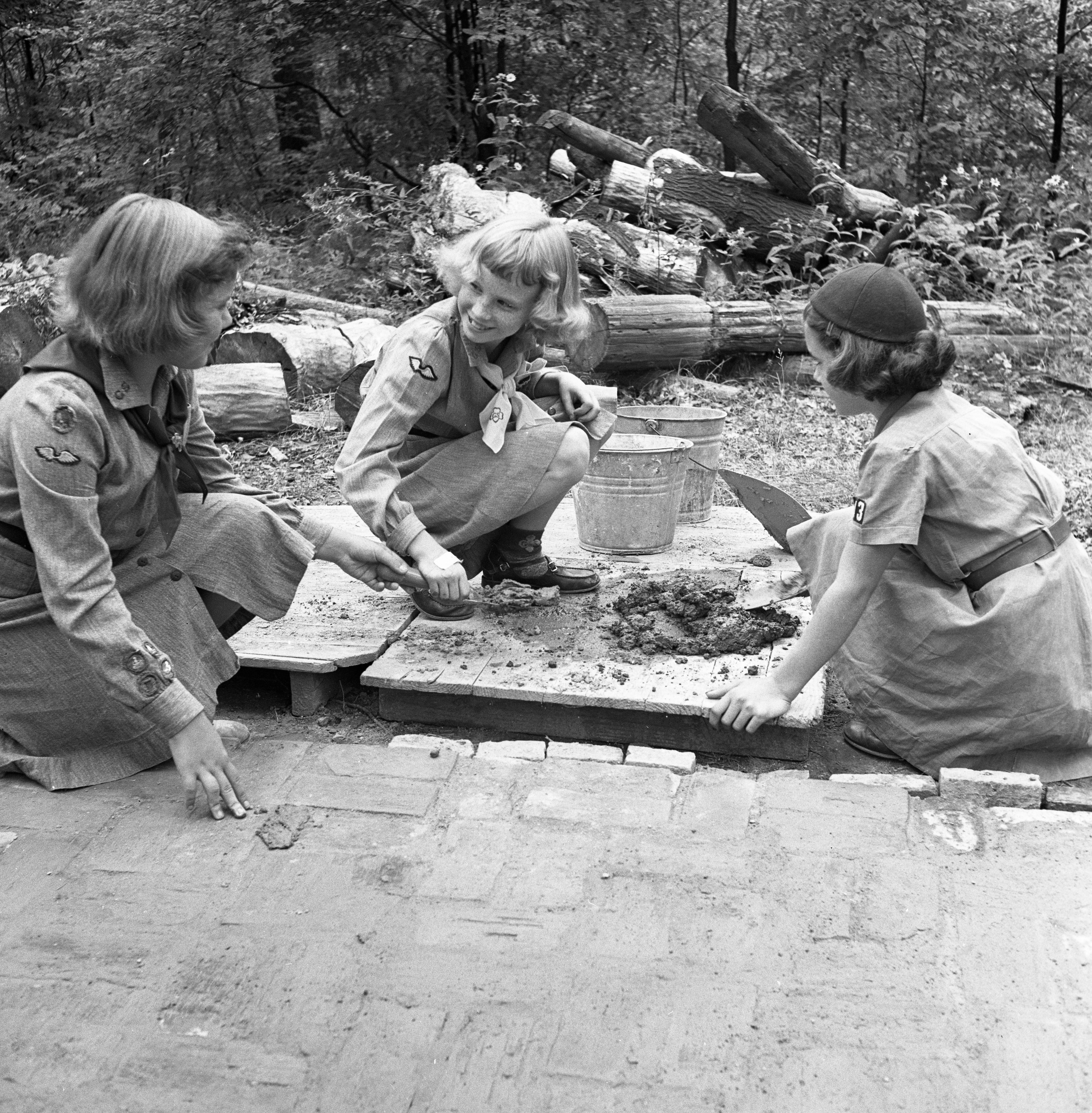 Girl Scouts Fixing Up Grounds at  Camp Hilltop, August 1951 image
