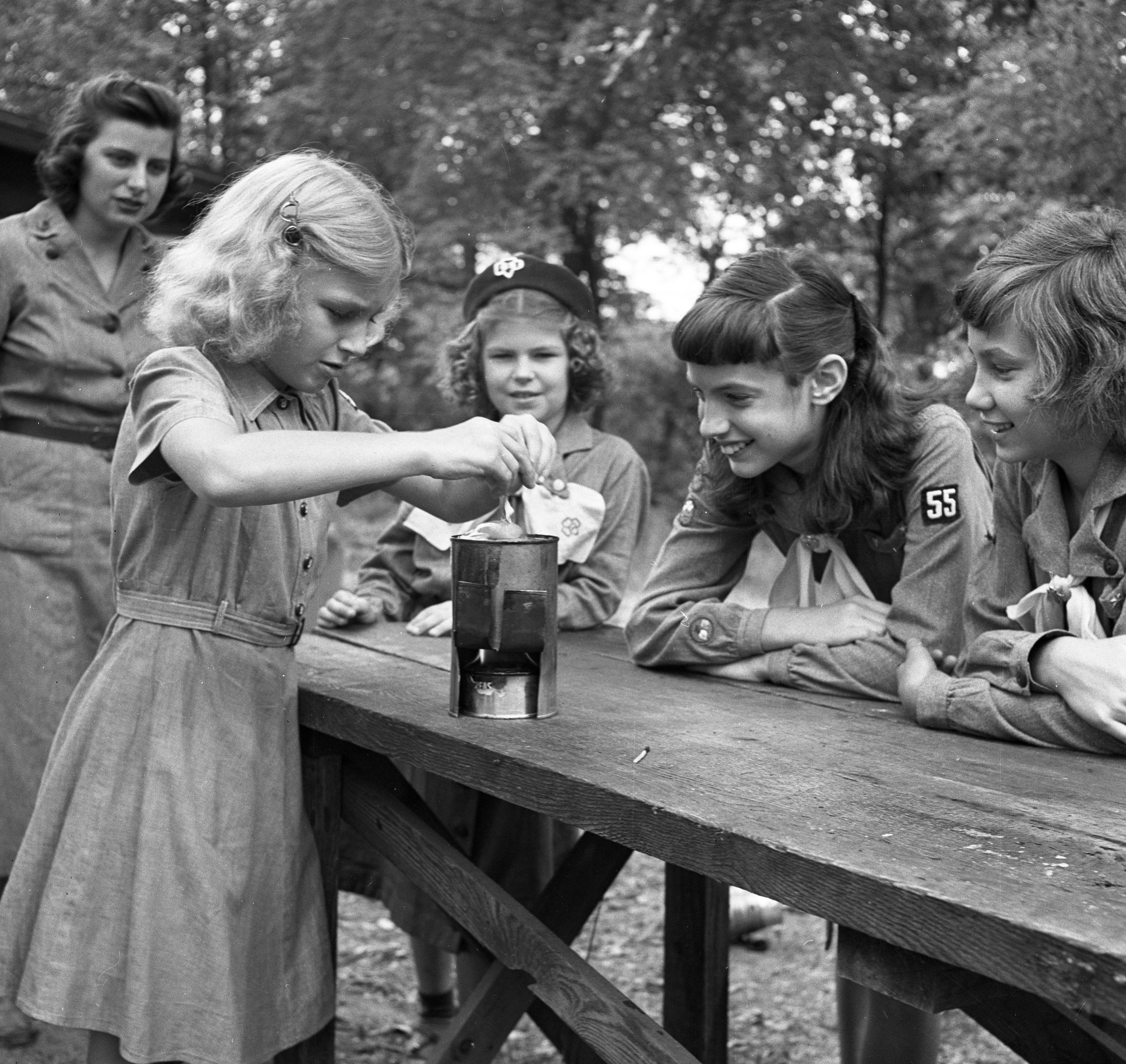 Girl Scouts Cook By Candlepower at  Camp Hilltop, August 1951 image