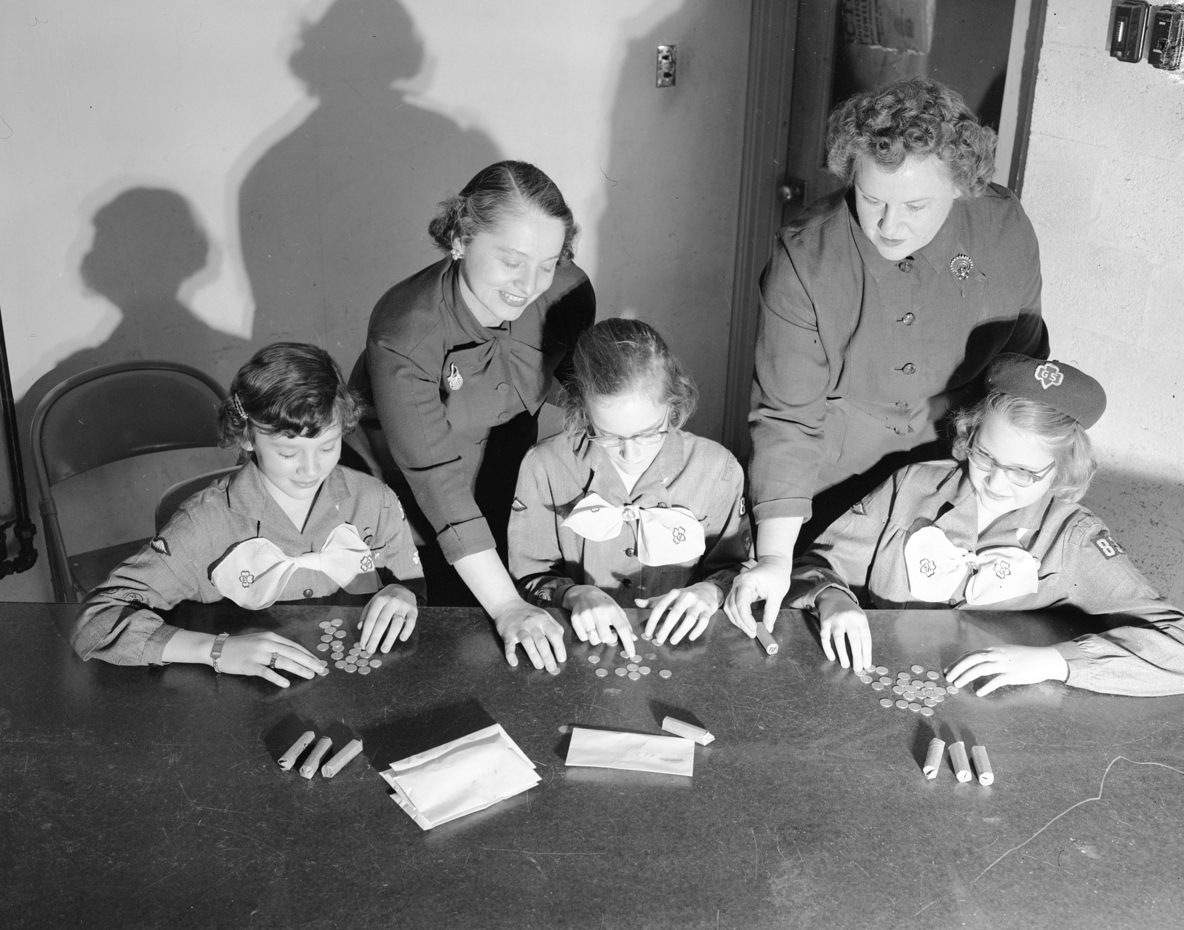 Girls Scouts Count Money For March of Dimes, January 1955 image