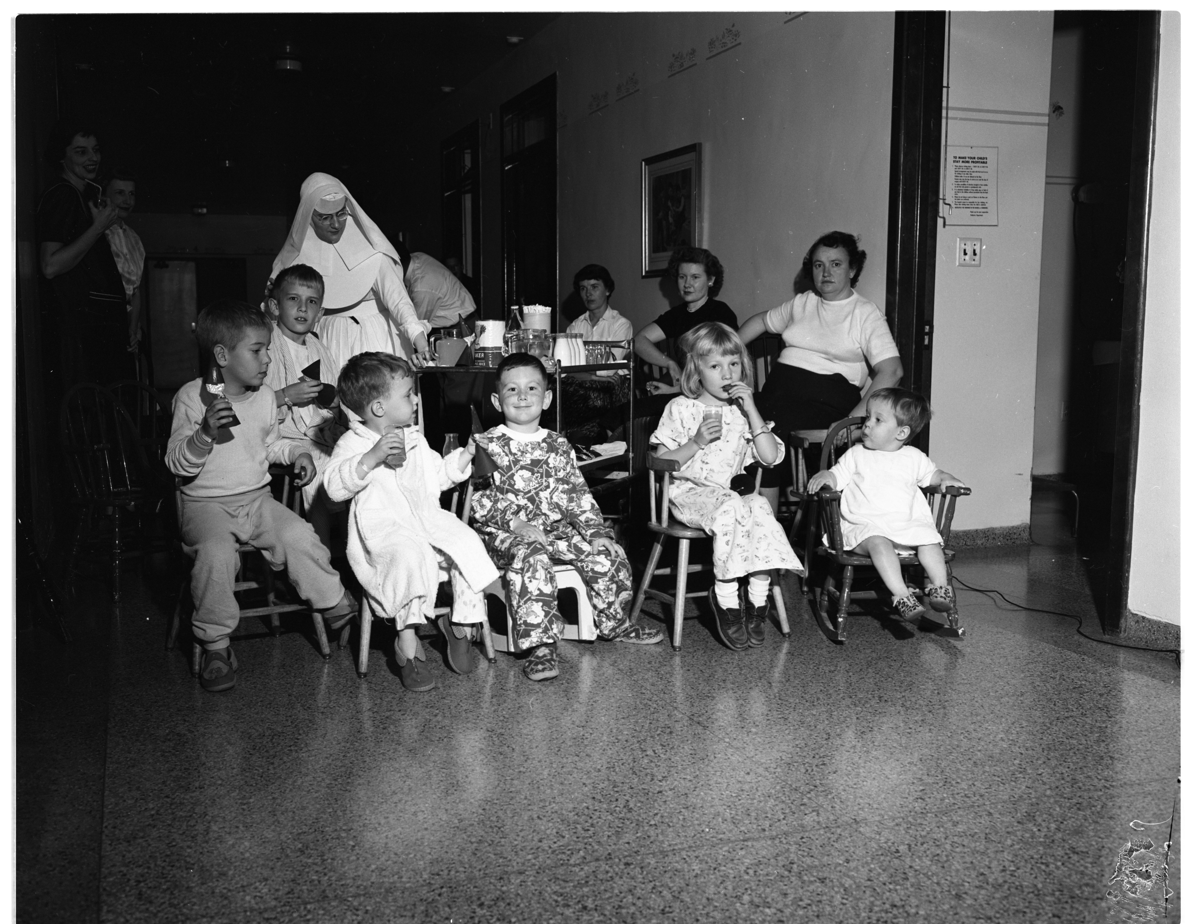 Young St. Joseph Hospital Patients Enjoy Movie Sponsored By Kiwanis Club, November 1956 image