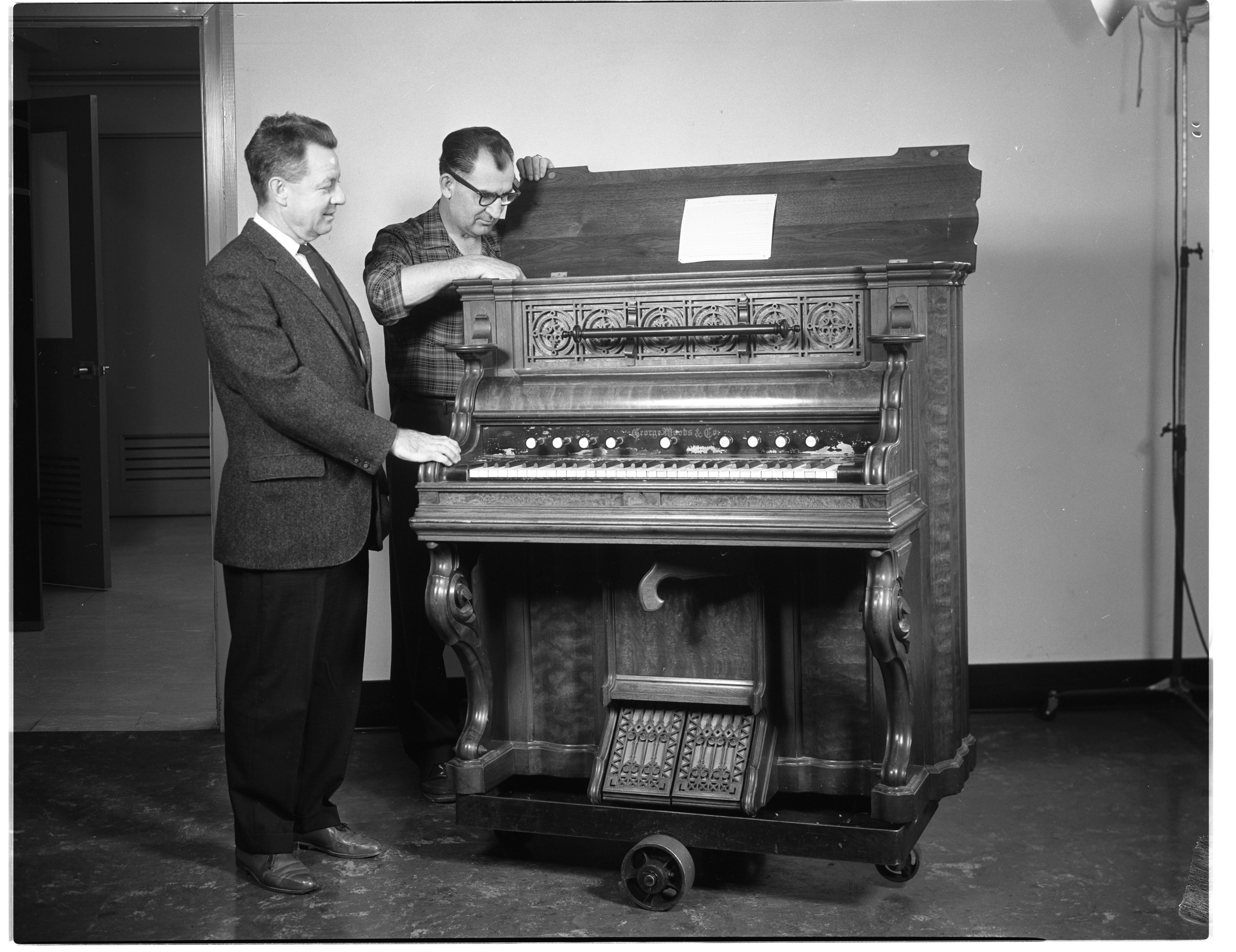 Kiwanis Club Accepts Valuable Woods Pump Organ For Annual Rummage Sale, November 1963 image