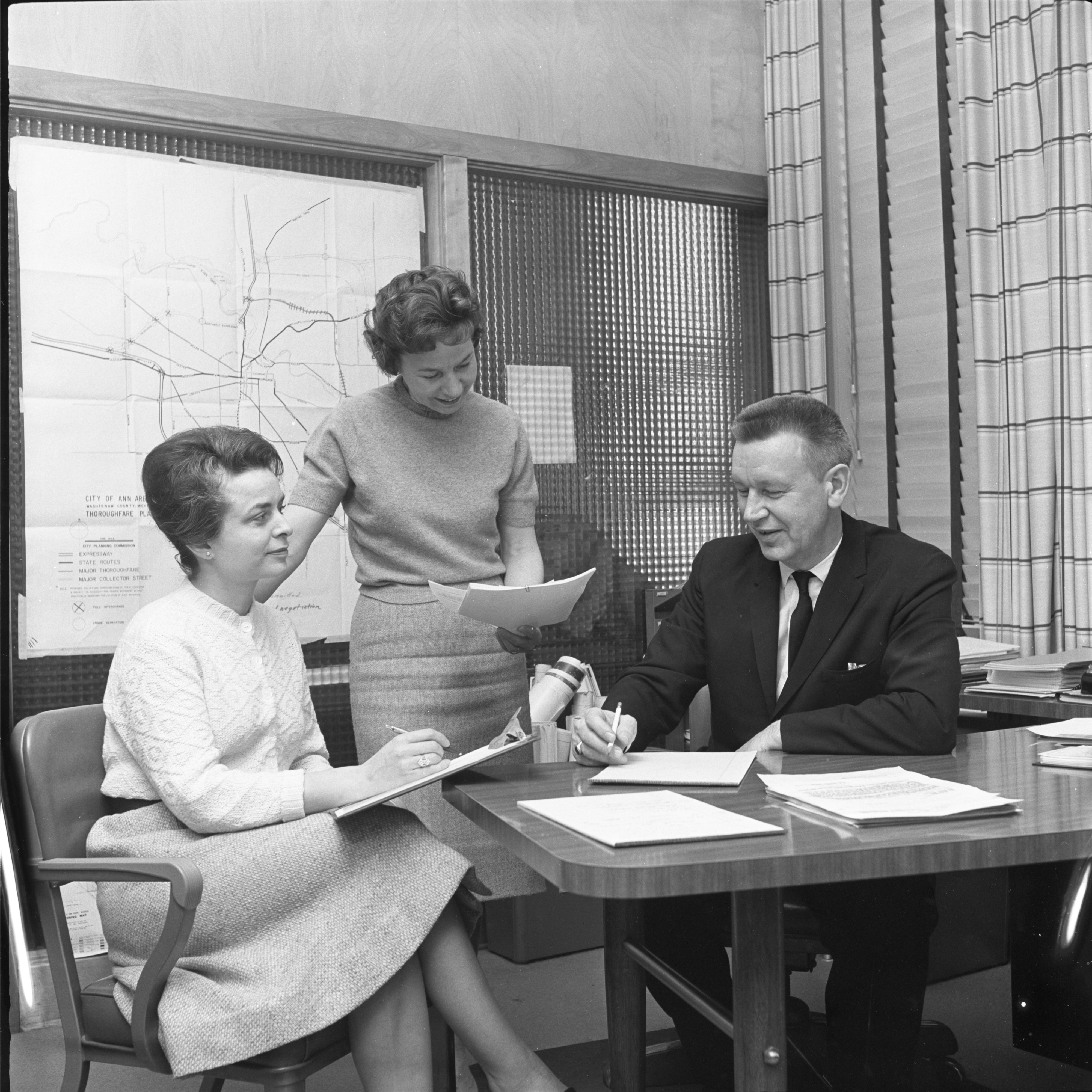 City Administrator Guy C. Larcom jr. Is Interviewed By League Of Women Voters Members, March 1962 image