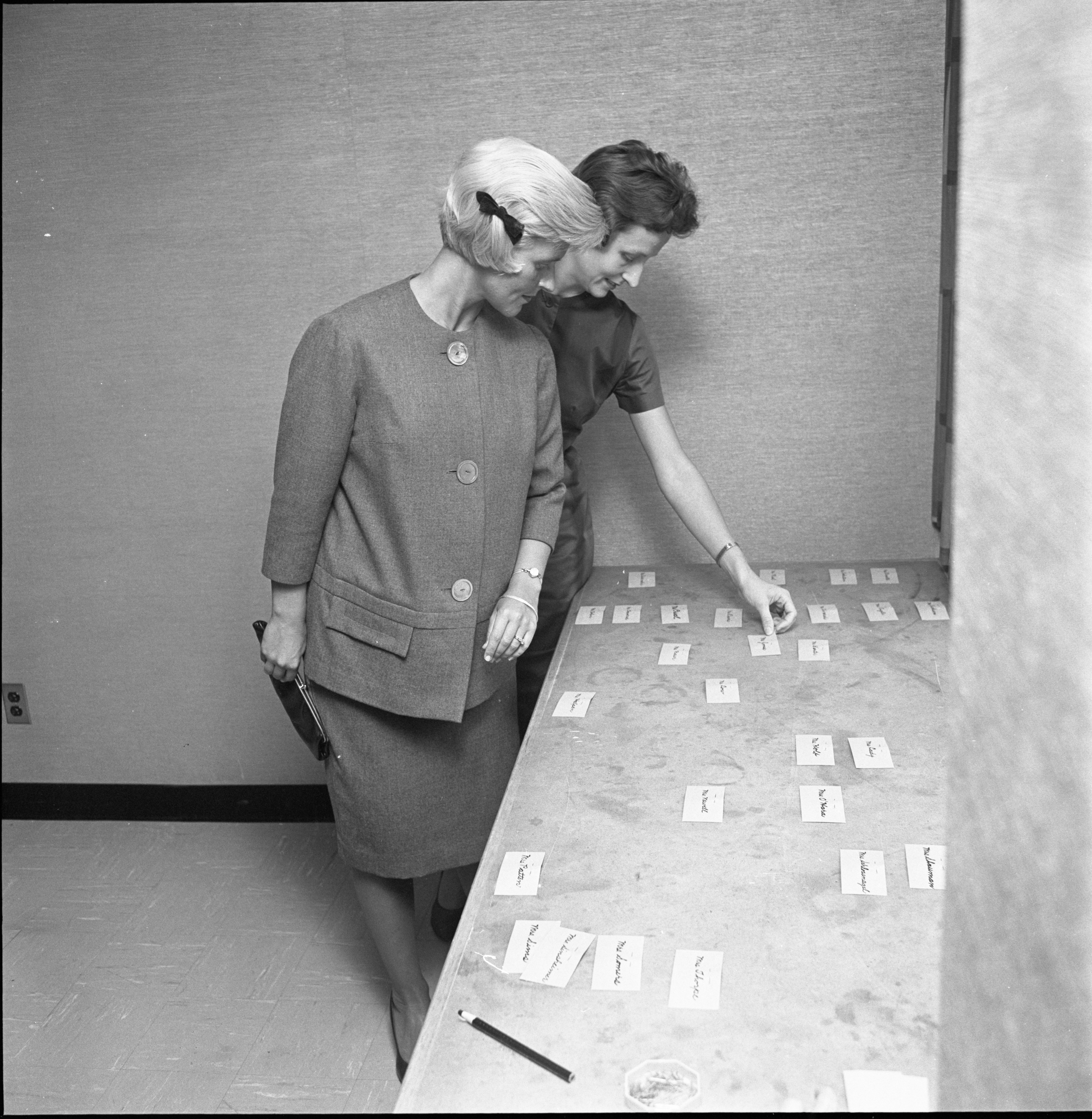 Guests Find Their Name Tags At The League Of Women Voters Annual Membership Dessert, September 1962 image
