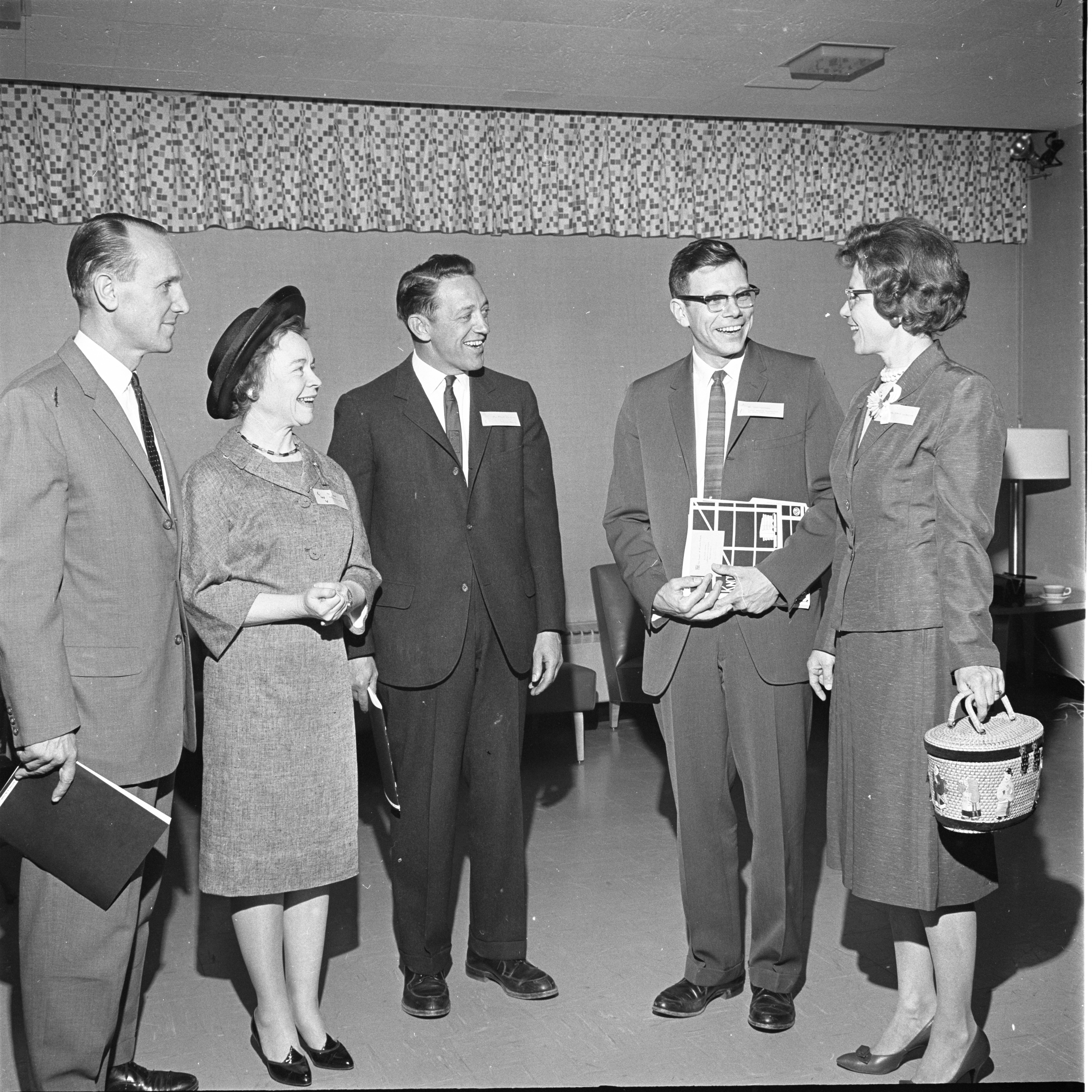 Ann Arbor School Officials & LWV Members Chat At A League Of Women Voters Meeting, April 1963 image