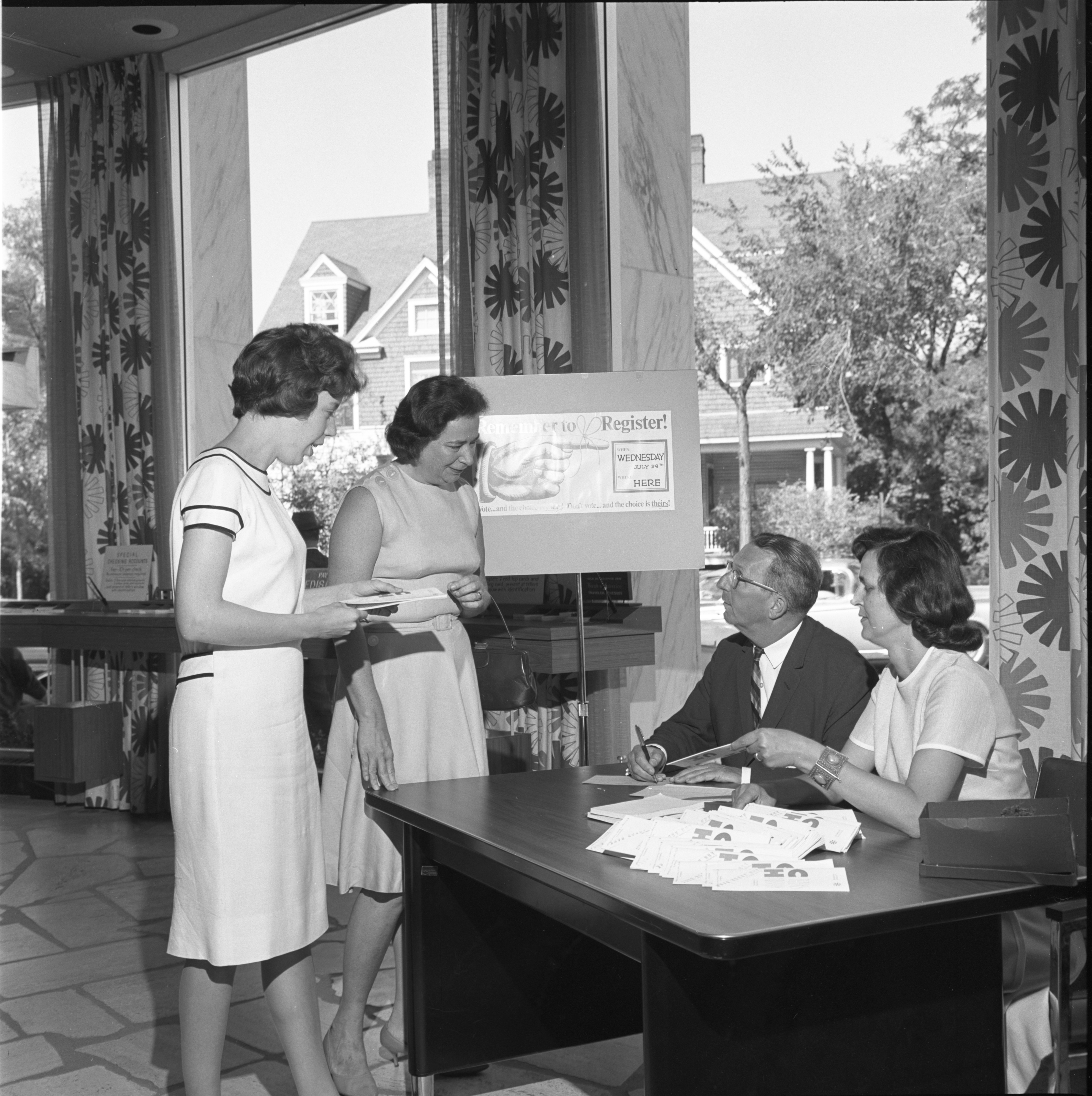 League Of Women Voters Promote Voter Registration At Ann Arbor Bank, July 1964 image