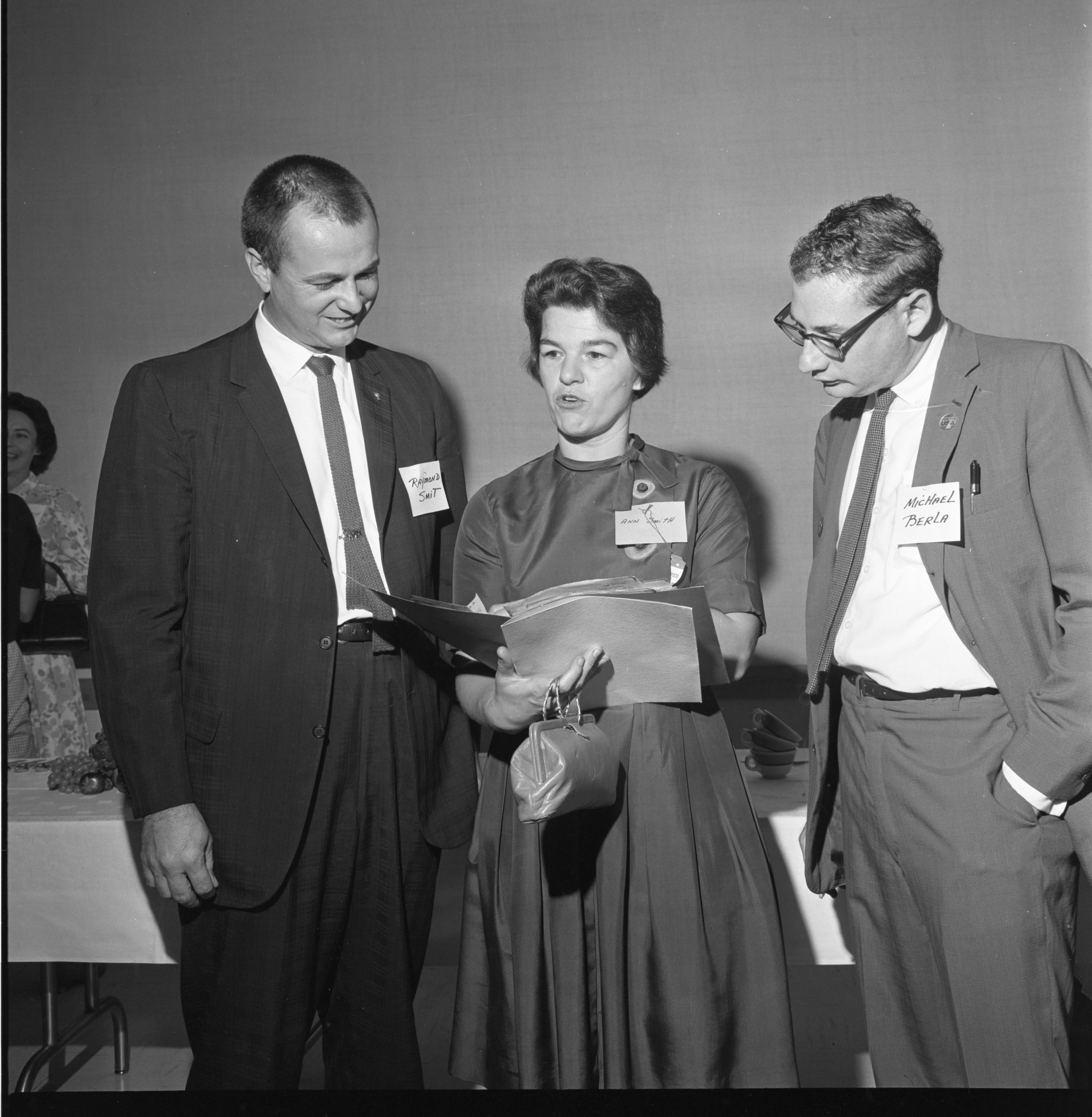 Ann Smith Talks Politics With Raymond Smit & Michael Berla At The League Of Women Voters Annual Meeting, September 1964 image