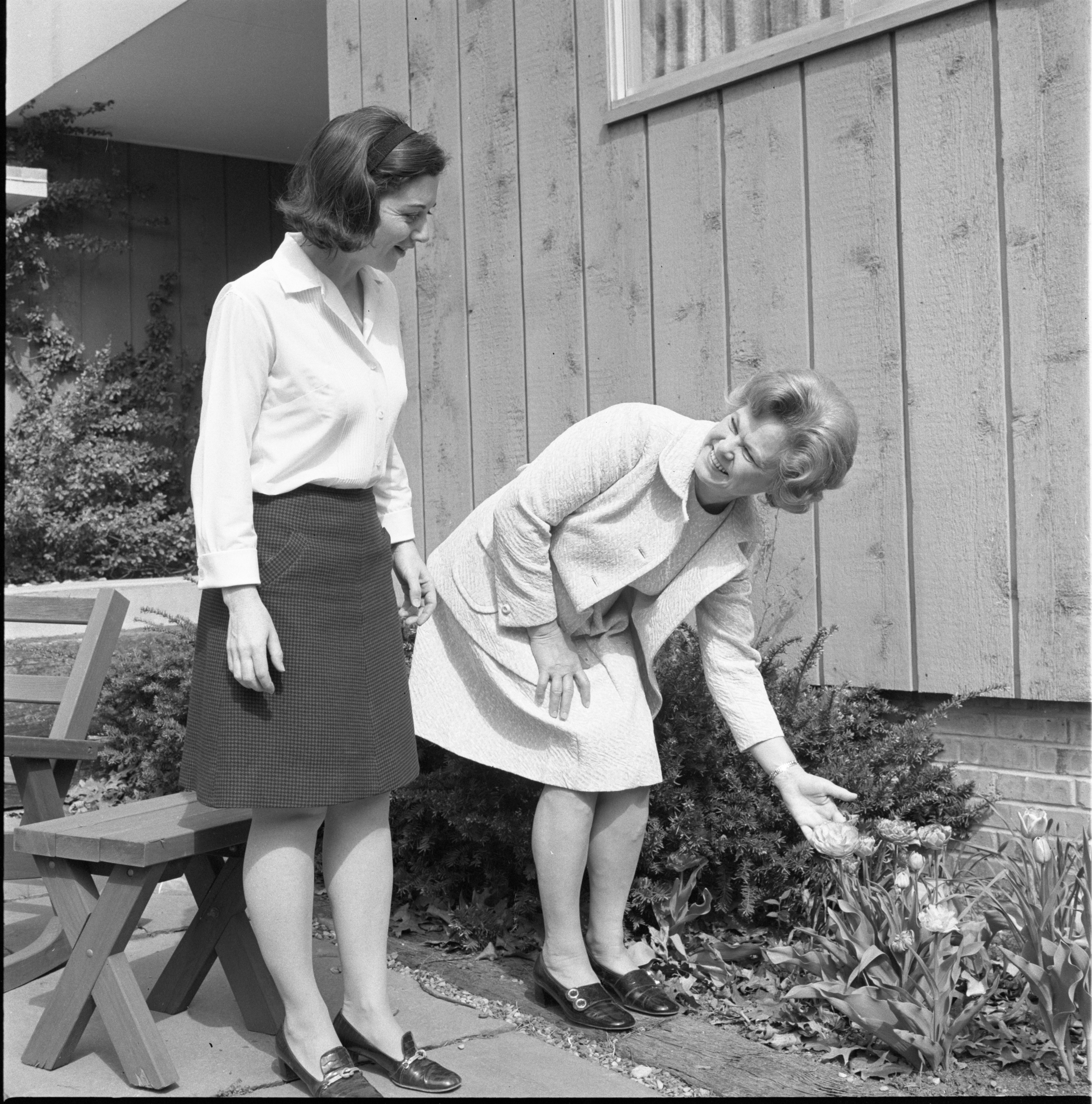 Cynthia Cross & Ann Joiner Admire Flowers Outside The Joiner Home, May 1971 image