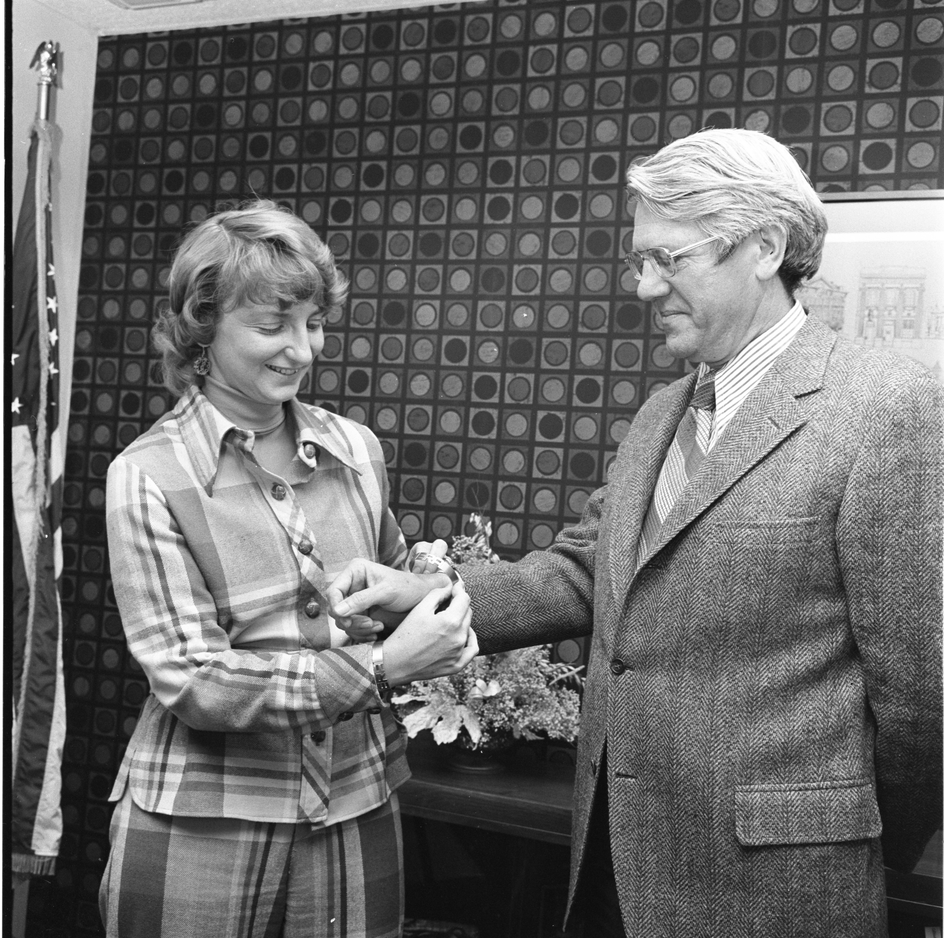 Mayor Stephenson Receives An Equal Rights Amendment Bracelet From LWV President Naomi Gottlieb, December 1973 image