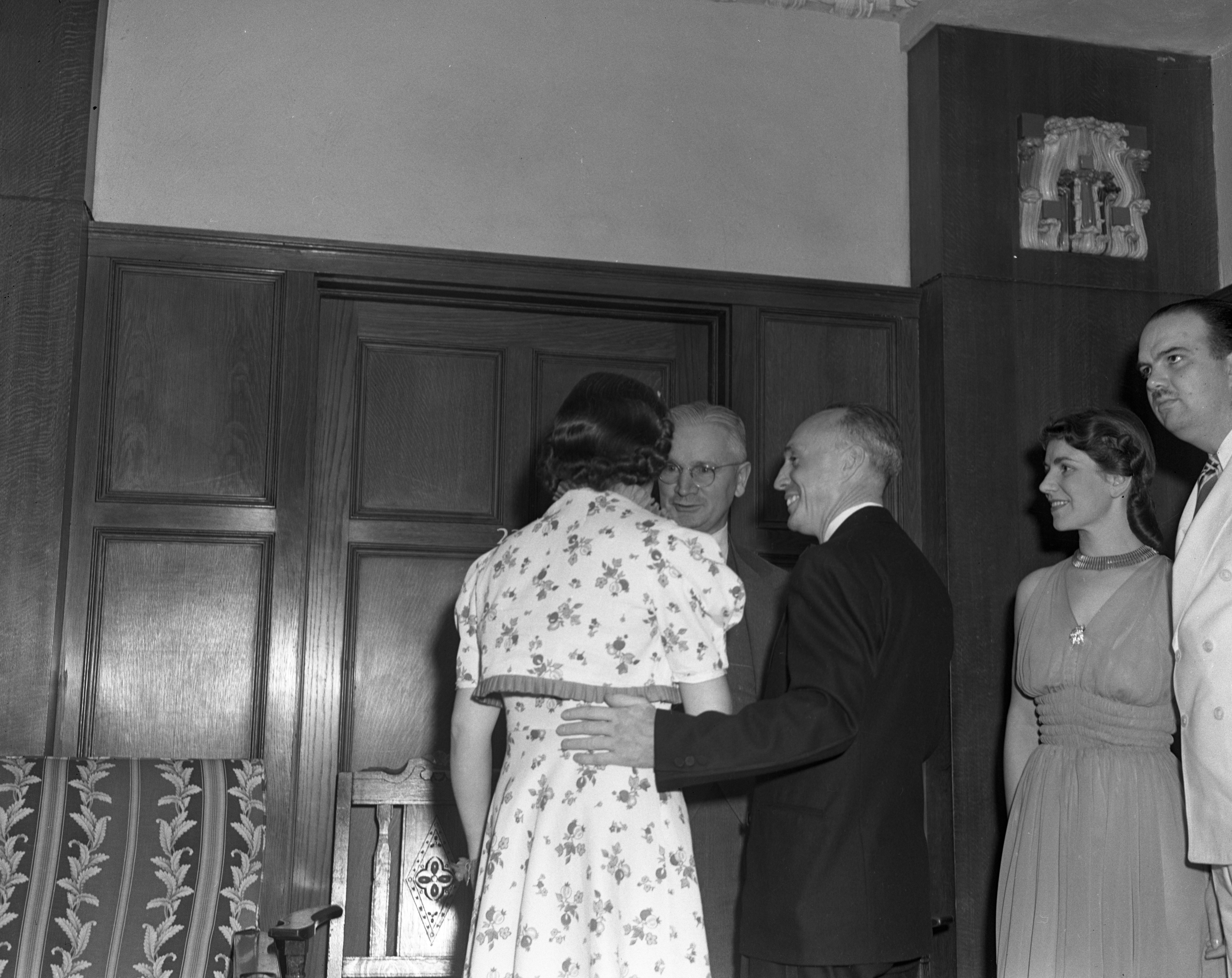 Mr. & Mrs. Harold C. Baker Chat With Justice Sharpe At The Ann Arbor Lions Club 10th Anniversary Dinner, June 1940 image