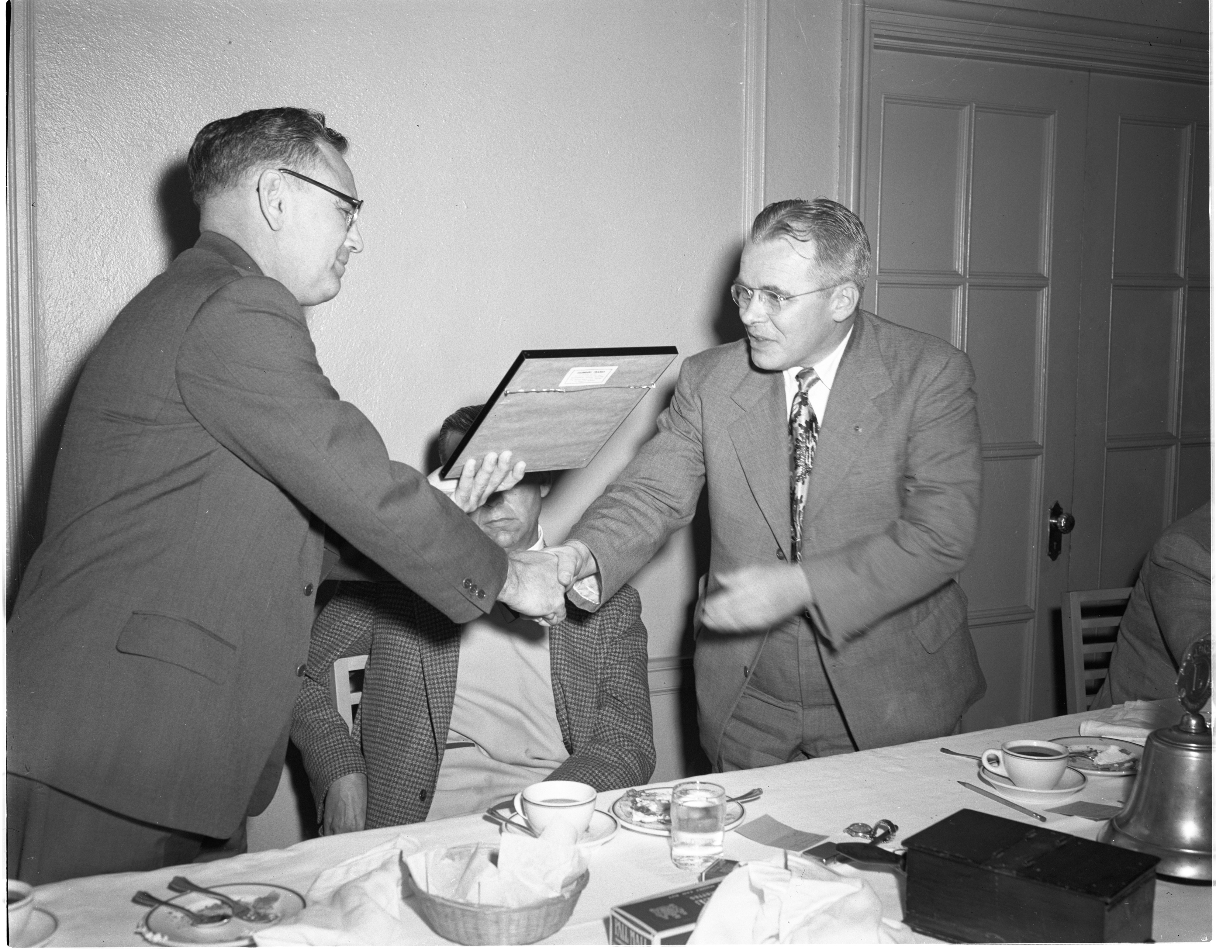 Elmer Mayer Of The Graf-O'Hara Post, VFW, Presents An Award To Ann Arbor Lions Club President Raymond Garner, May 1953 image