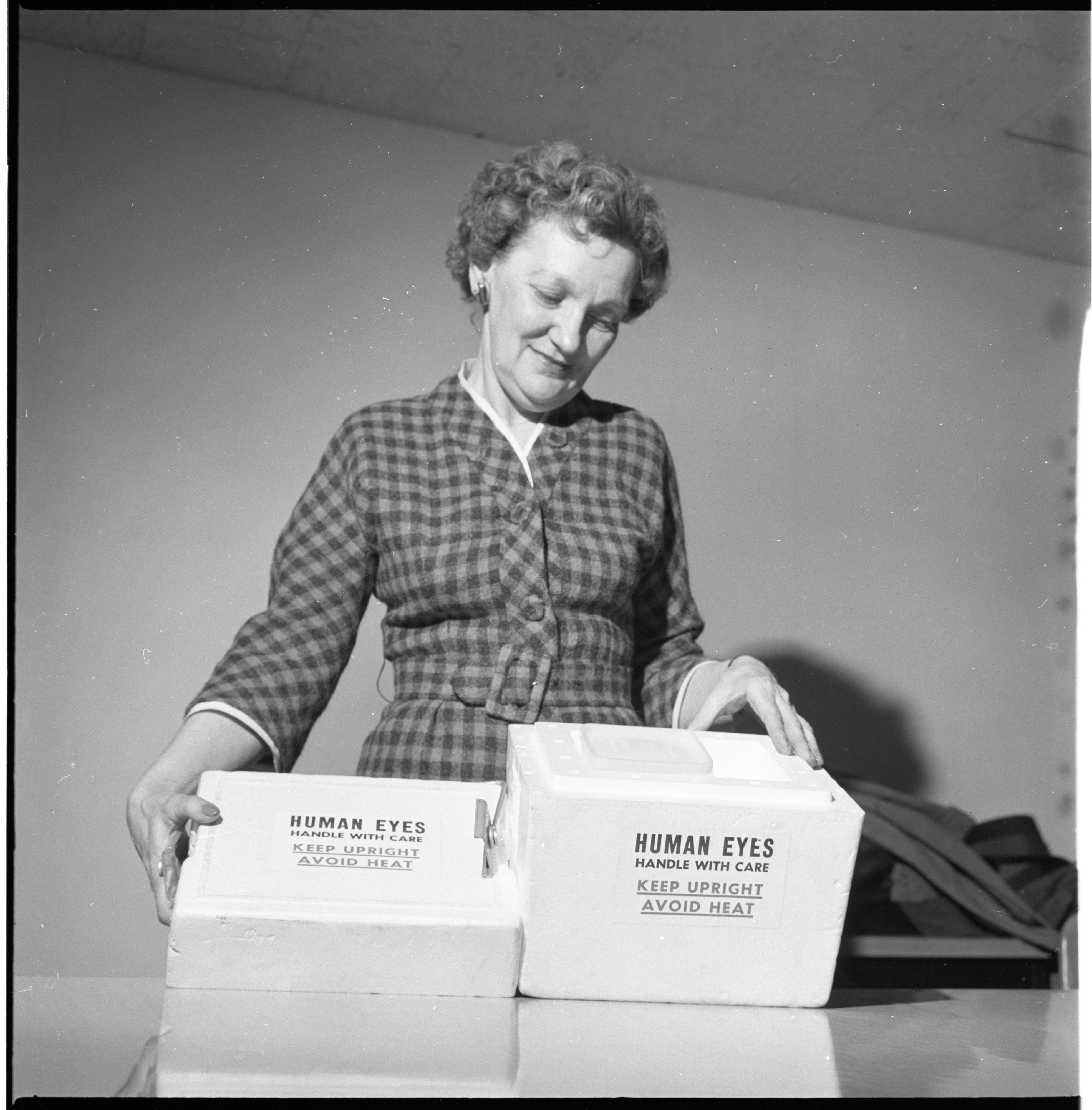 Mary F. Hubbell, Michigan Eye Bank, Displays Container For Transporting Donor Eyes At Ann Arbor Lions Club Meeting, February 1963 image