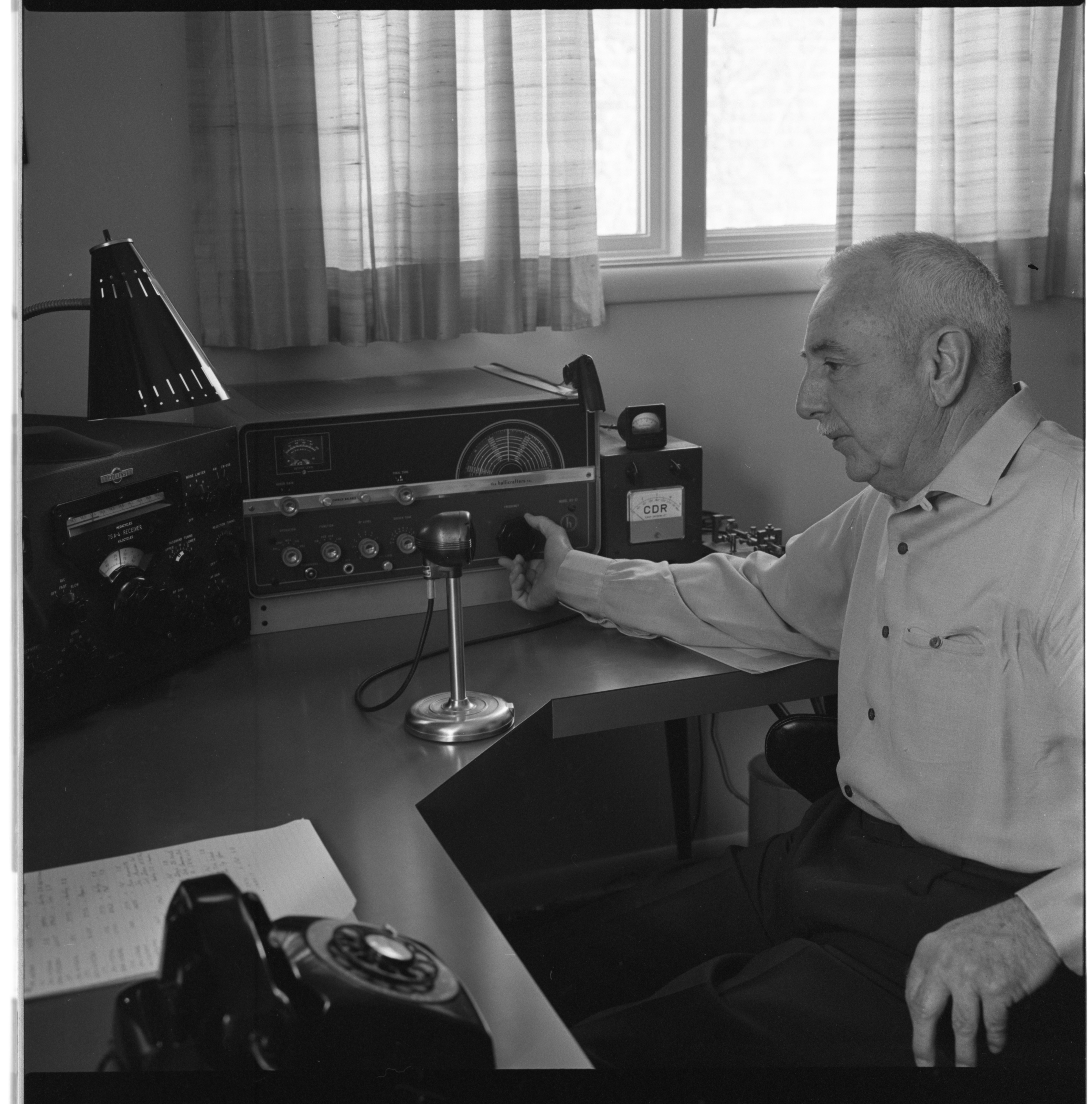 Robert V. Austin Tunes In On The Eye Bank Network With His Ham Radio, March 1964 image