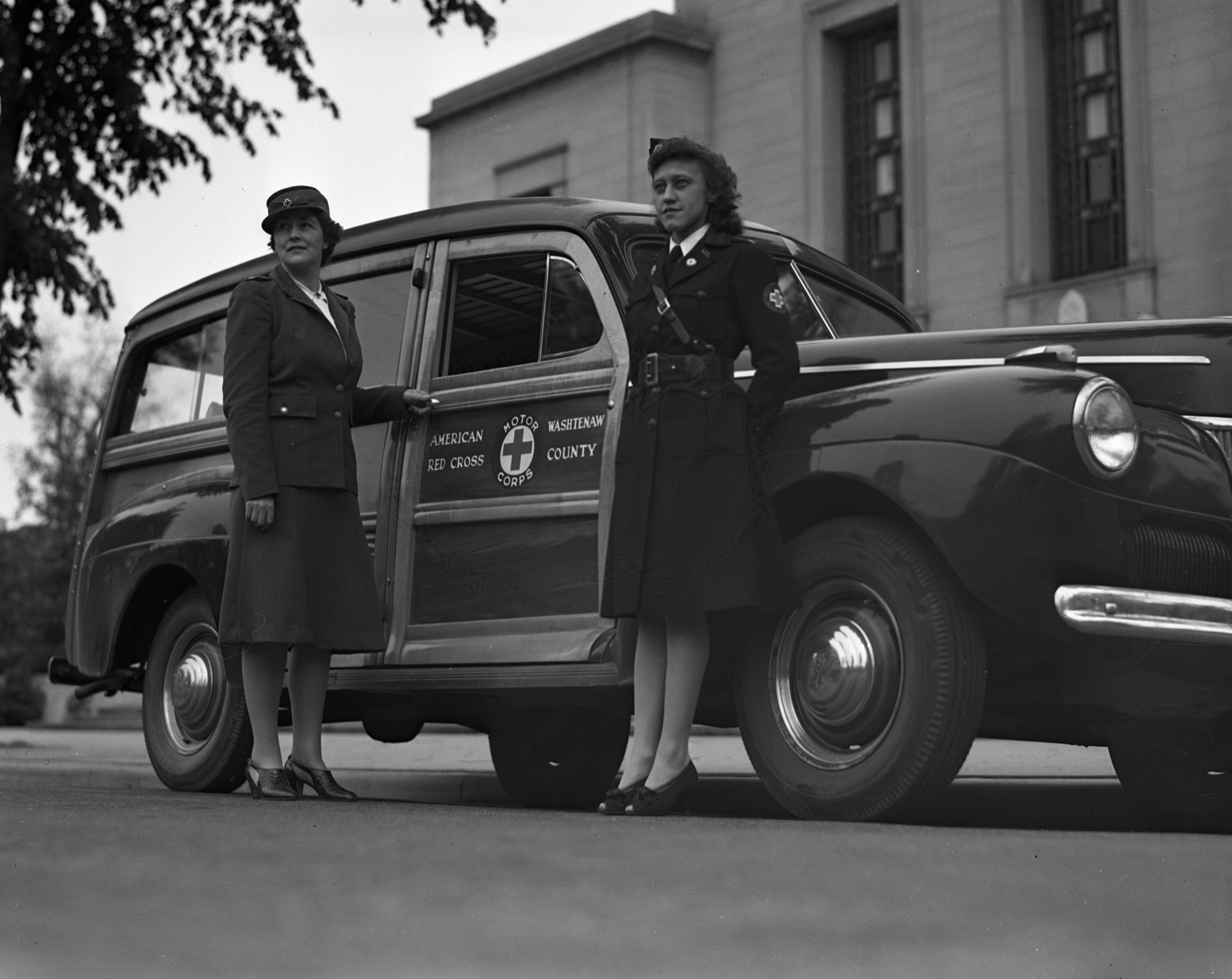 Mrs. Malin and Mrs. Bridges with Red Cross Motor Corps station wagon, May 1942 image