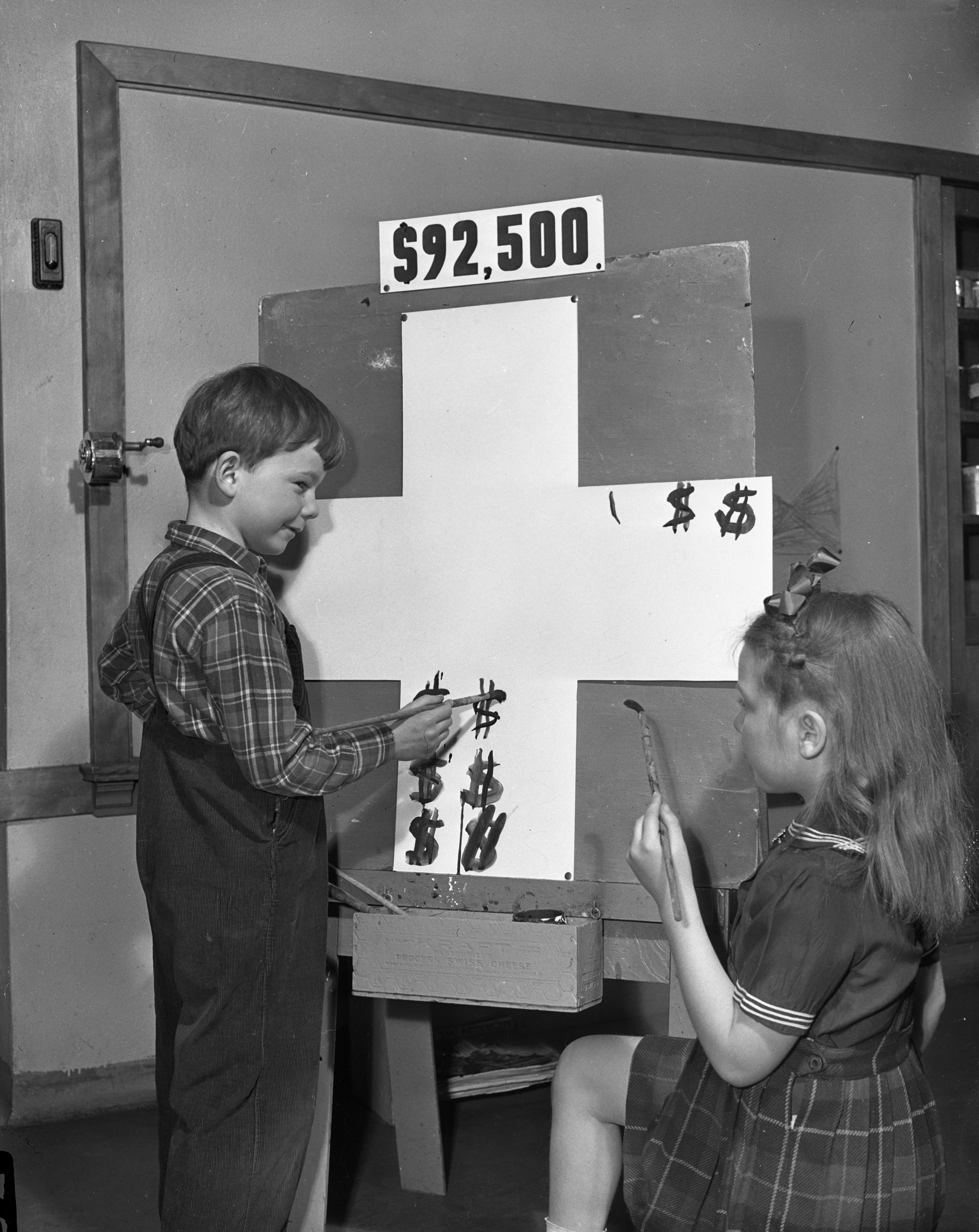 Campbell Smith (representing Ann Arbor) and Sue Pierce (representing the county outside Ann Arbor) Show the Red Cross Drive's Daily Score, March 9, 1944 image
