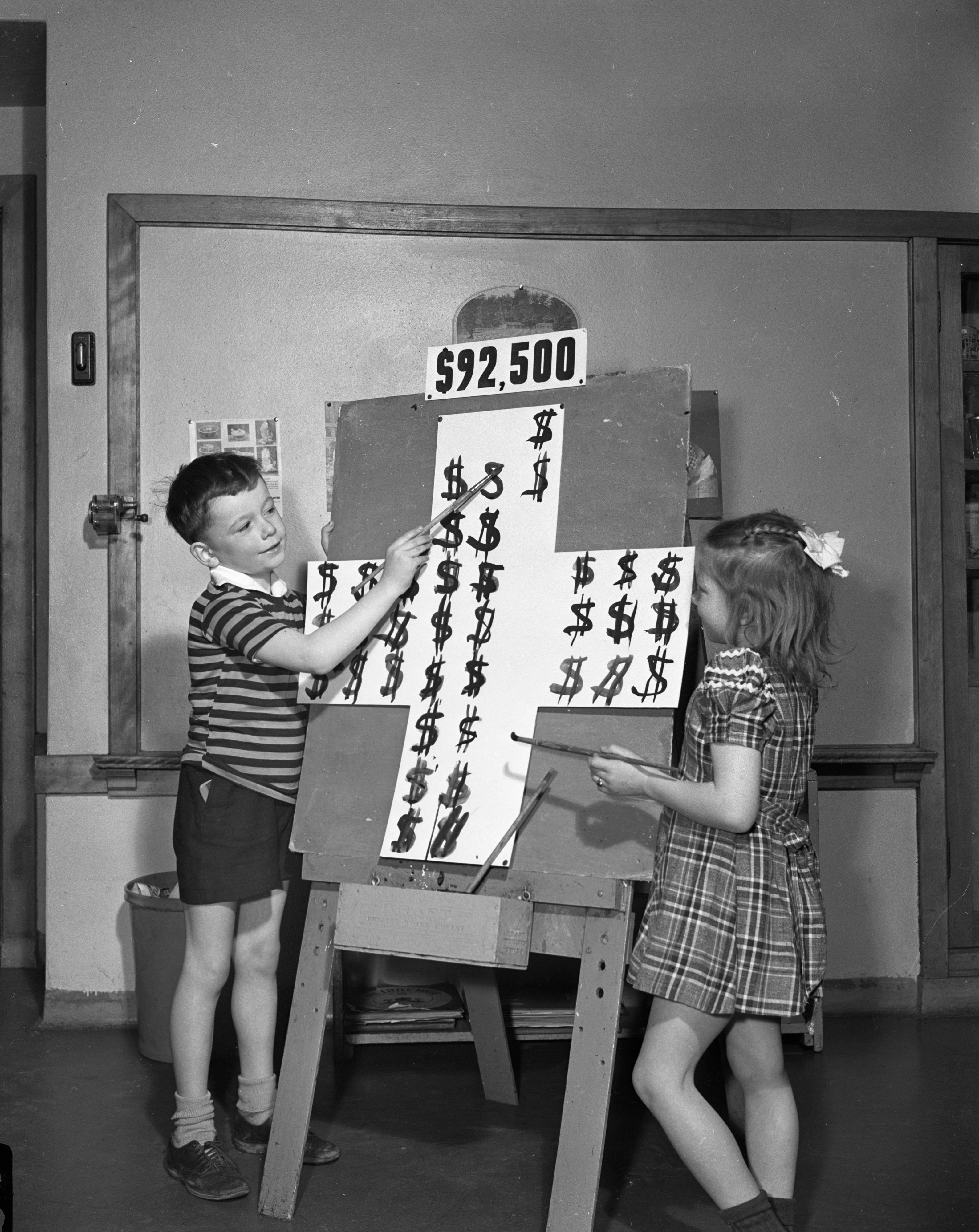 Campbell Smith (representing Ann Arbor) and Saundra Wares (representing the county outside Ann Arbor) Show the Red Cross Drive's Daily Score, March 21, 1944 image