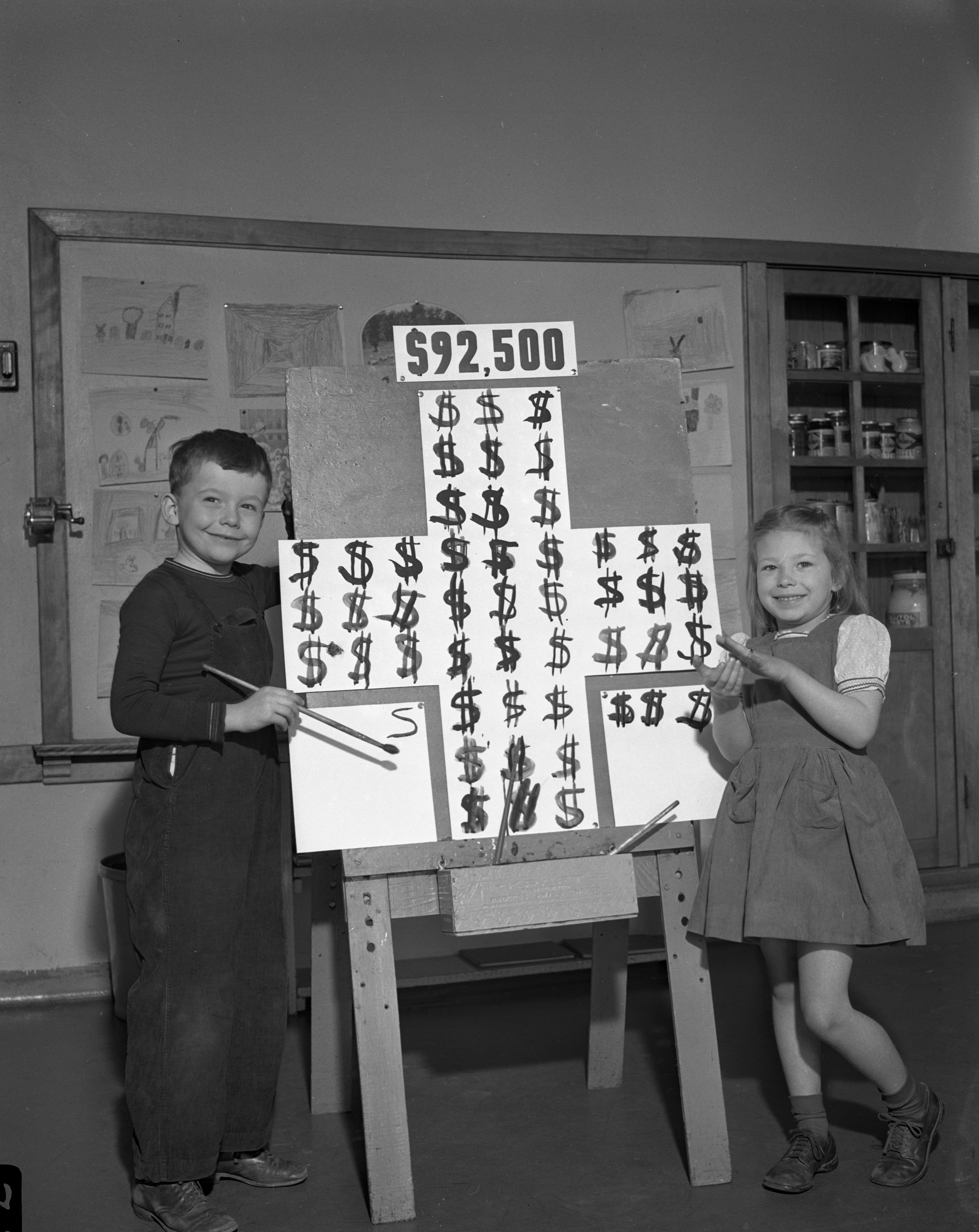 Campbell Smith (representing Ann Arbor) and Saundra Wares (representing the county outside Ann Arbor) Show the Red Cross Drive's Daily Score, March 28, 1944 image