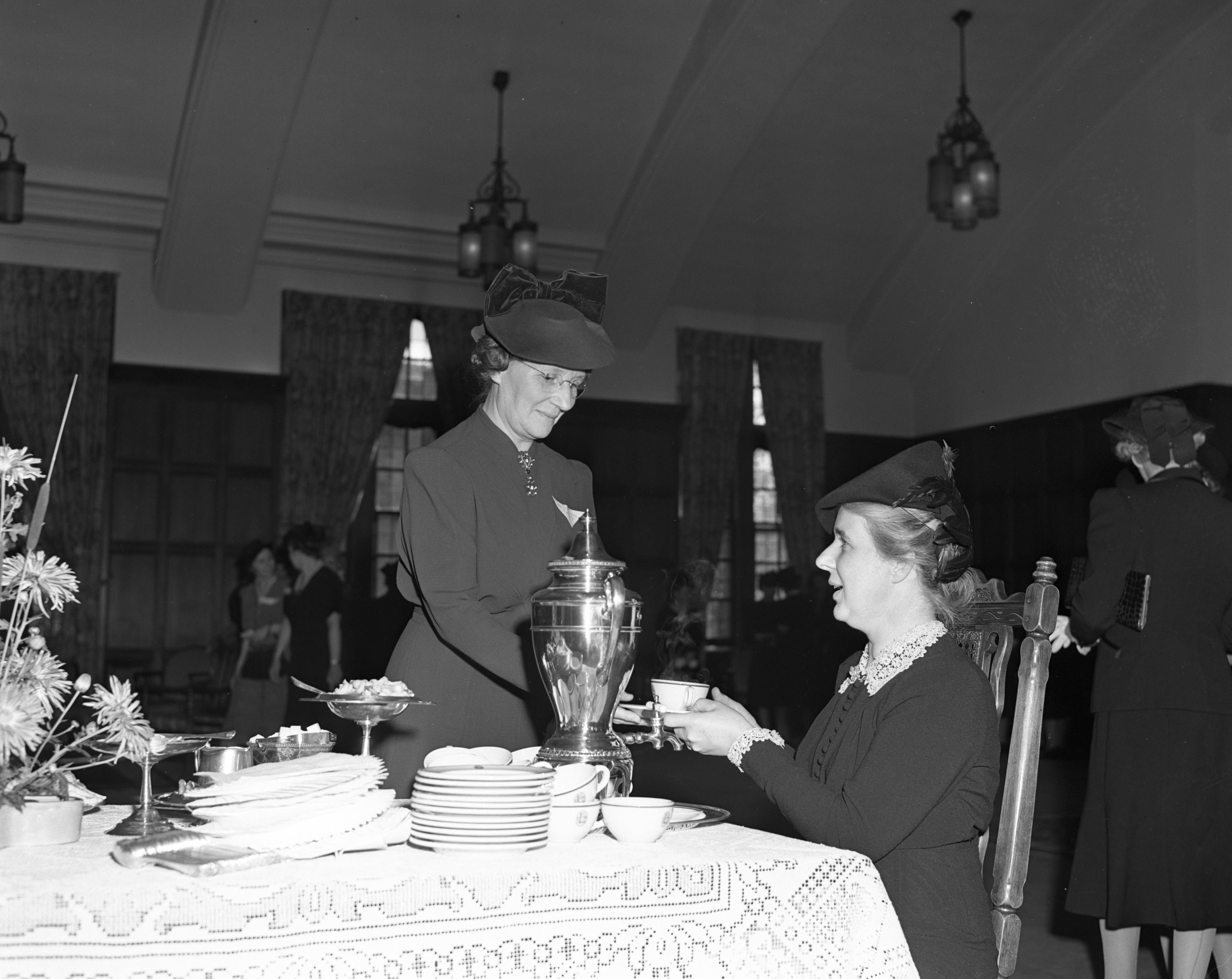 Sybel K. Bennett serving Mrs. Crawford at Faculty Women's Club, October 1940 image