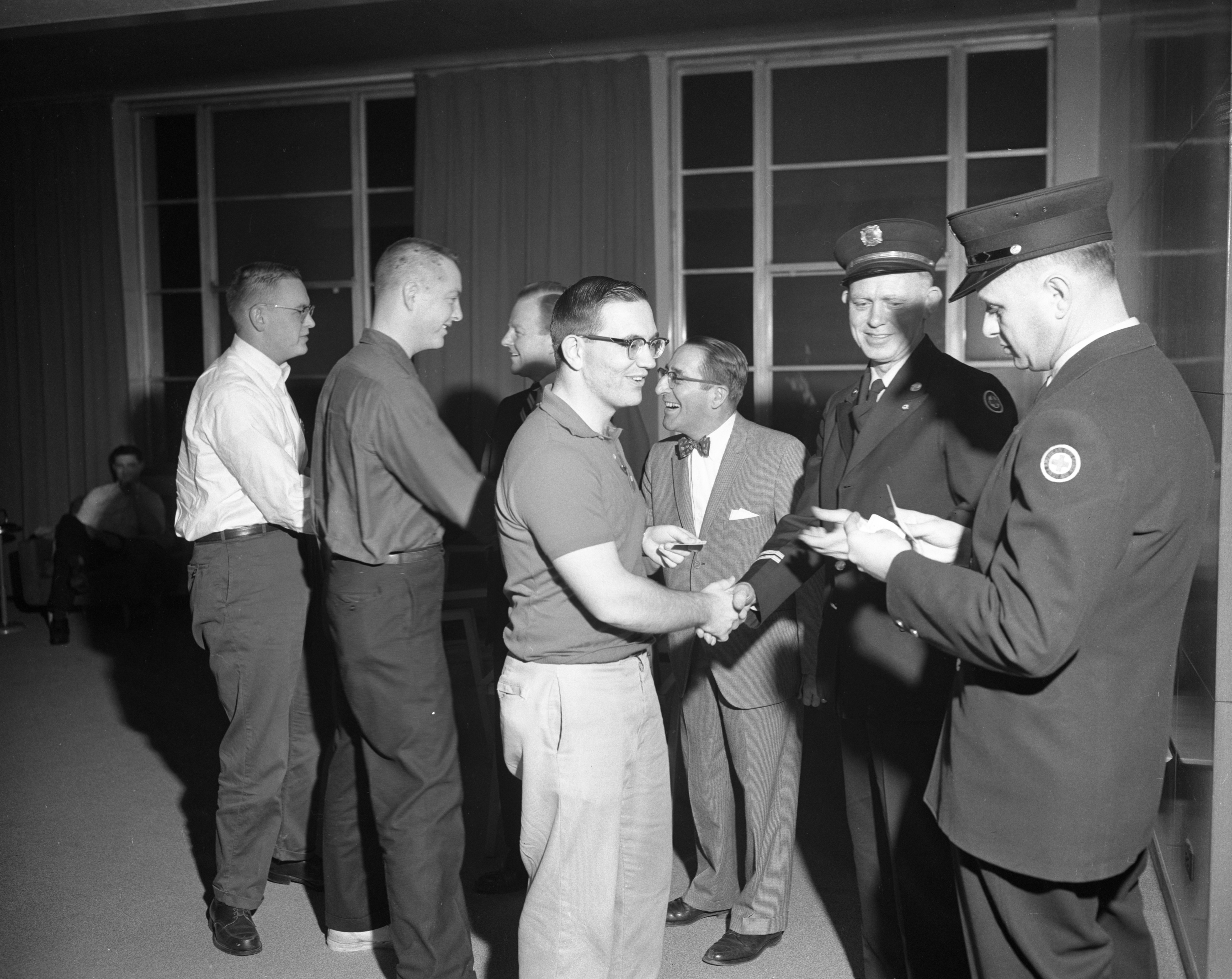 Peace Corps members complete an American Red Cross first aid class, January 1962 image