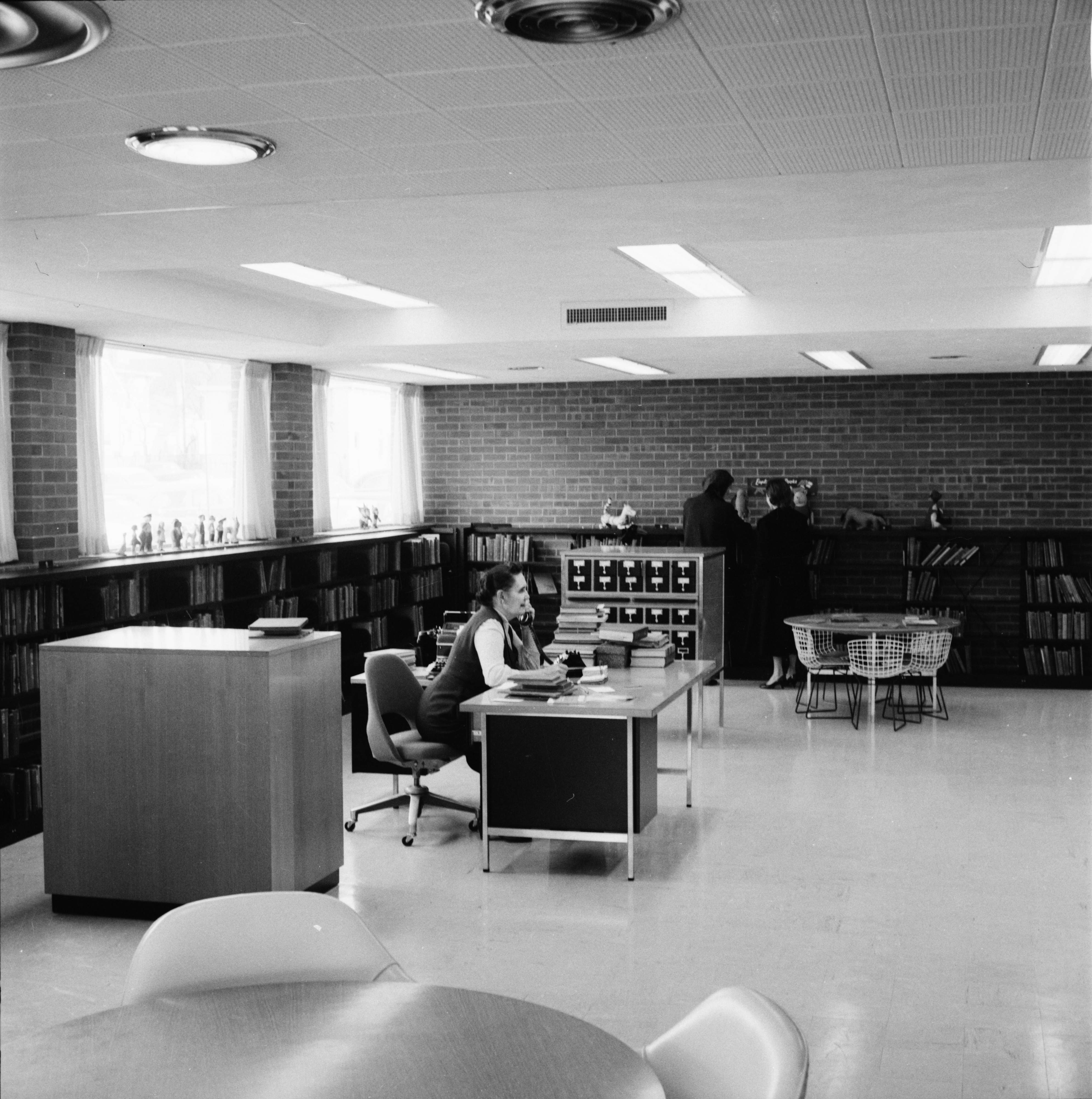Miss Hazel Keedle, Head of the Children's Department, in New Ann Arbor Public Library, March 1958 image